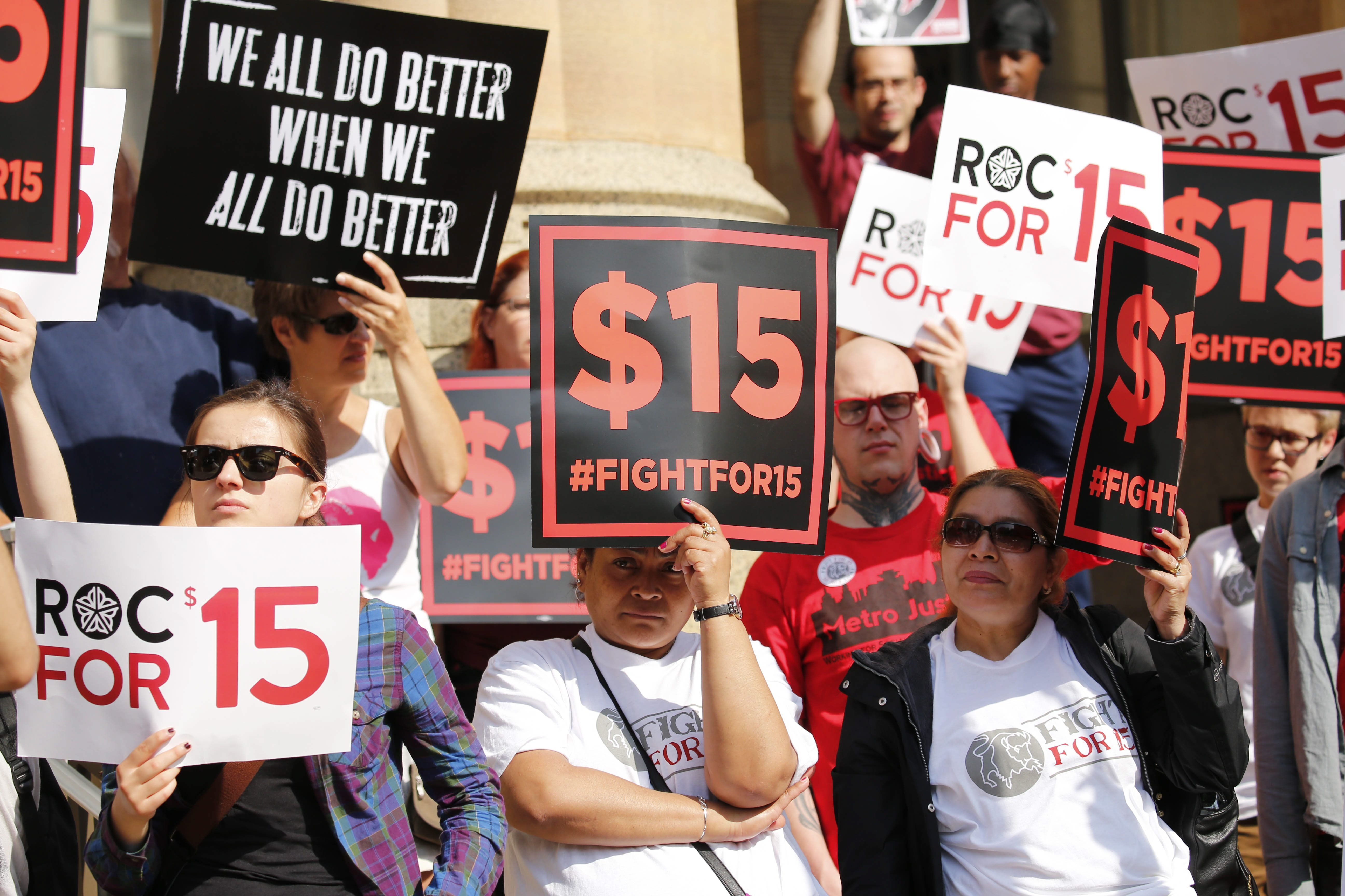 Demonstrators seeking a $15 minimum wage gathered on the steps of City Hall in June as the governor's Wage Board was meeting inside.