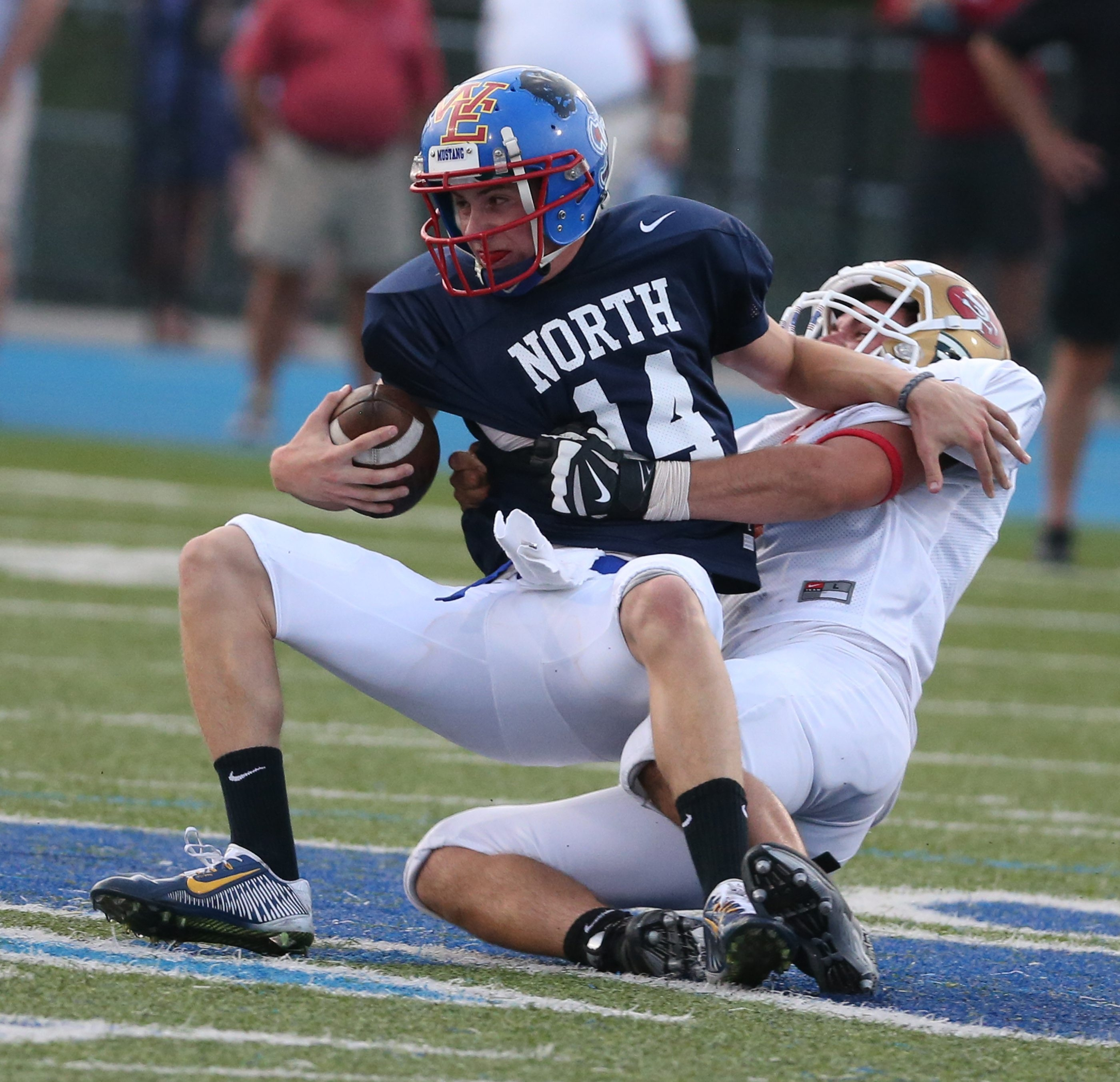 Brien Pacholec of the South sacks North's Jason Hellwig in Wednesday night's Kensington Lions All-Star game.