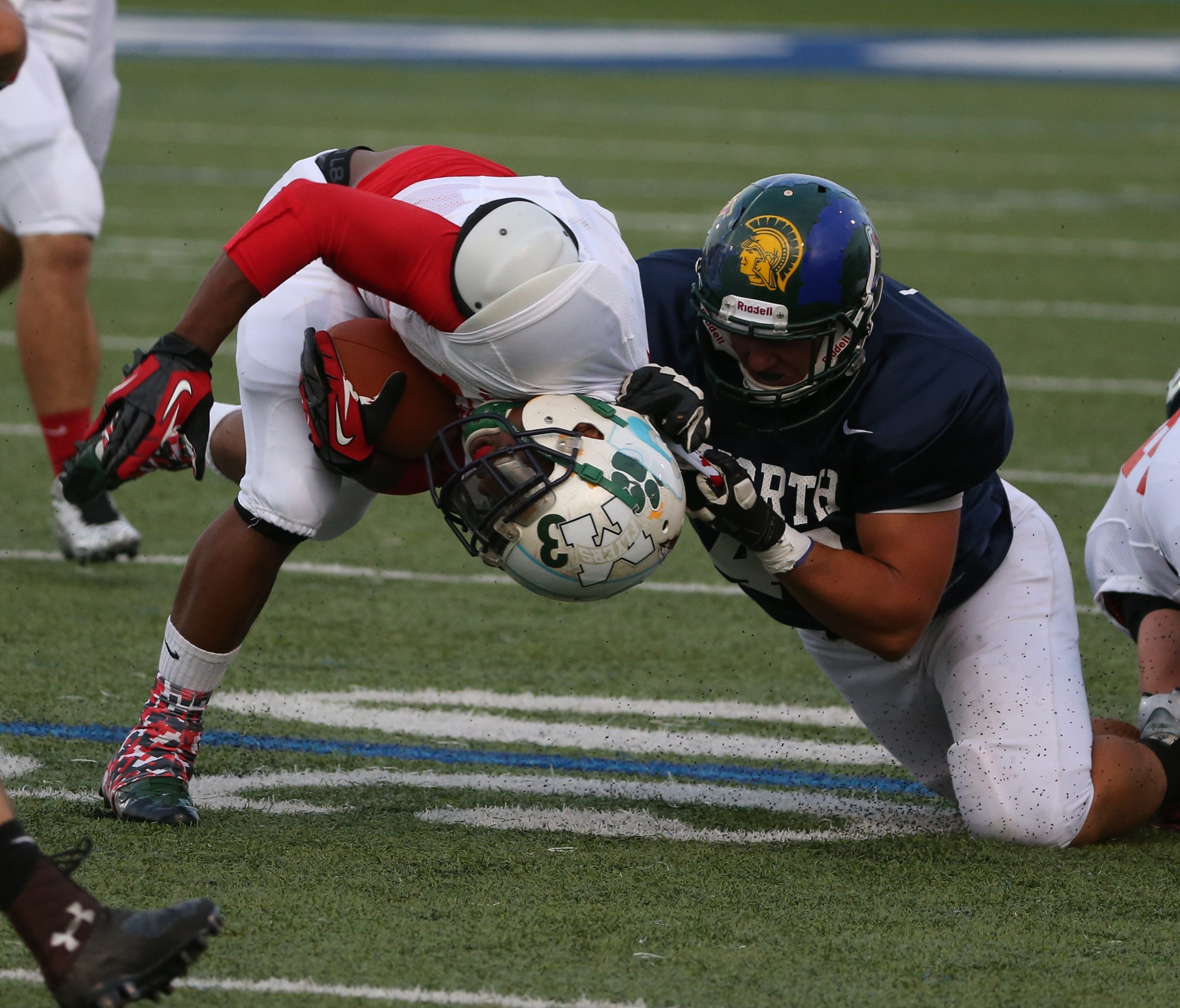 Jake Ames of the North squad tackles the South's Arenzo Thomas in the first quarter of the North's 26-10 victory in the Lions All-Star Classic.