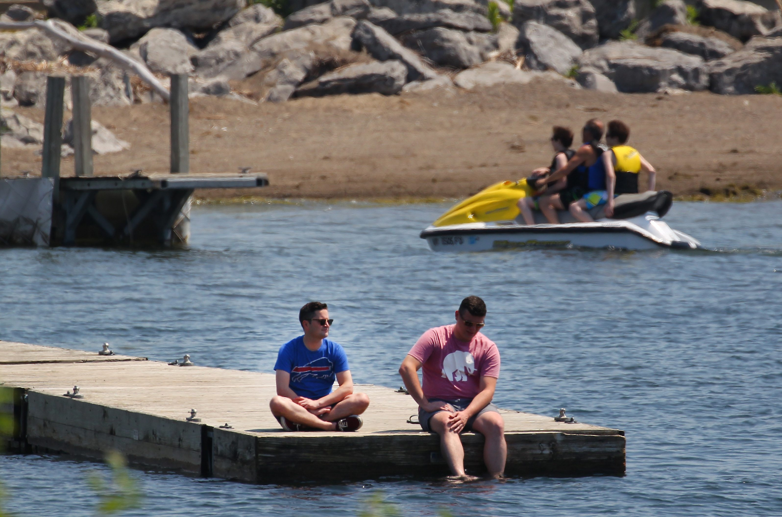 Harrison Walsh, left, and Luke McCann enjoy the cool breeze off the lake at Gallagher Beach in Buffalo on Monday. (Mark Mulville/Buffalo News)