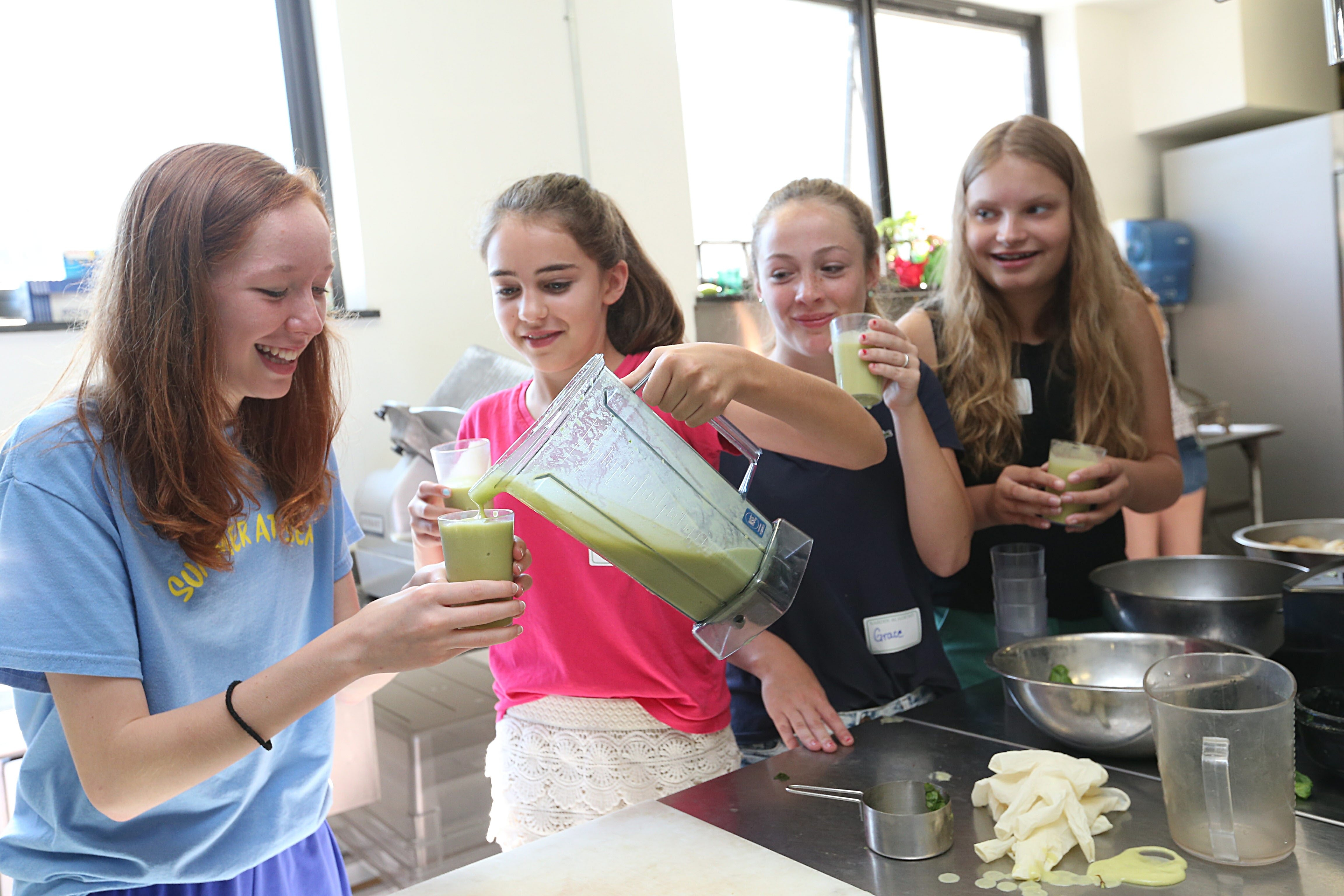 Tasting a Going Green smoothie that they made during a cooking class are, from left, eighth-graders Mary Liz Beyer, Anna Gioia, Grace McHale and Emily Desmond. The smoothie includes spinach, pineapple, banana and green grapes.