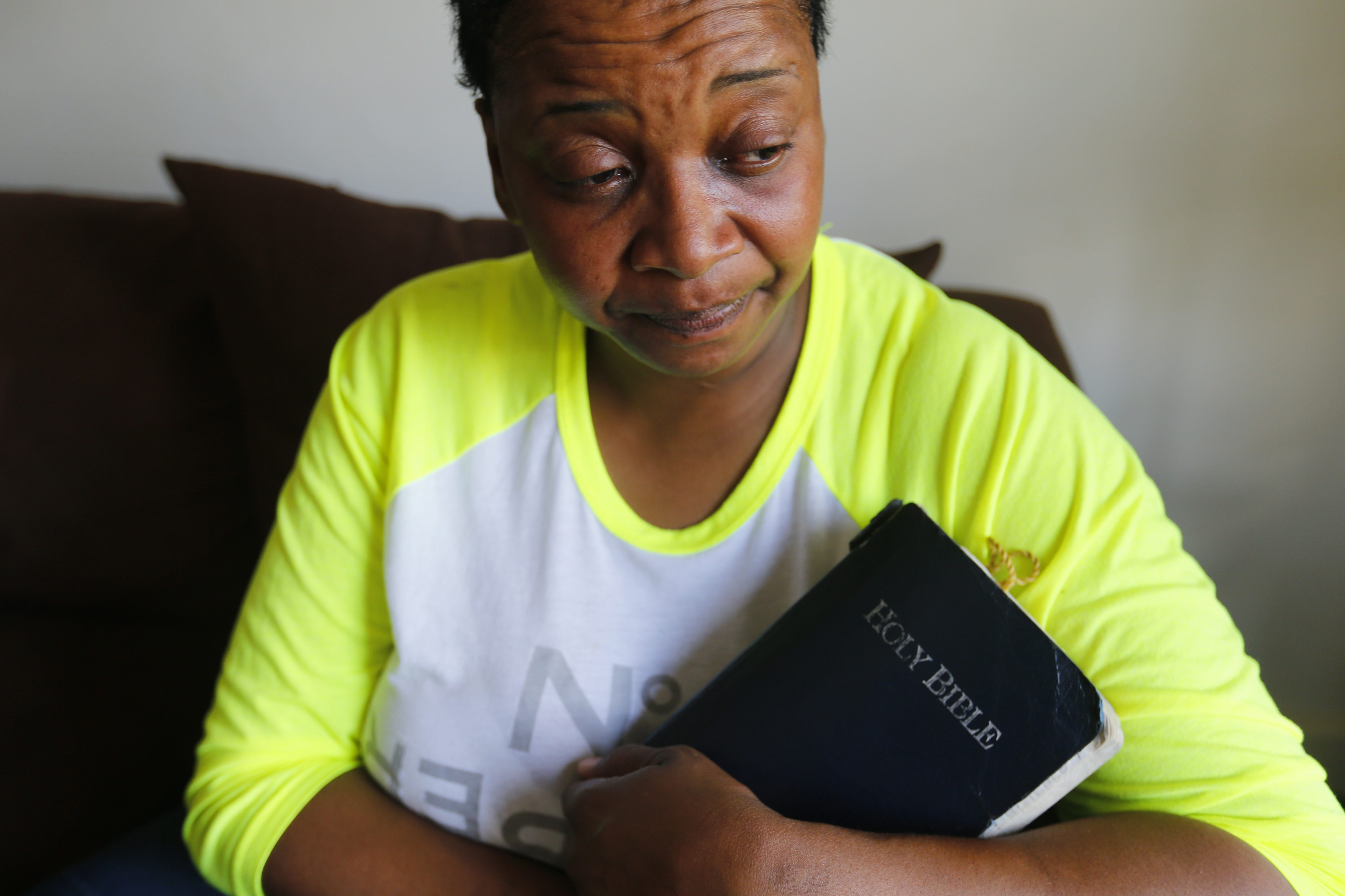 Kimberly Barnes, mother of shooting victim Curtis J. Smith Jr., holds on to her Bible in her Buffalo home Thursday.
