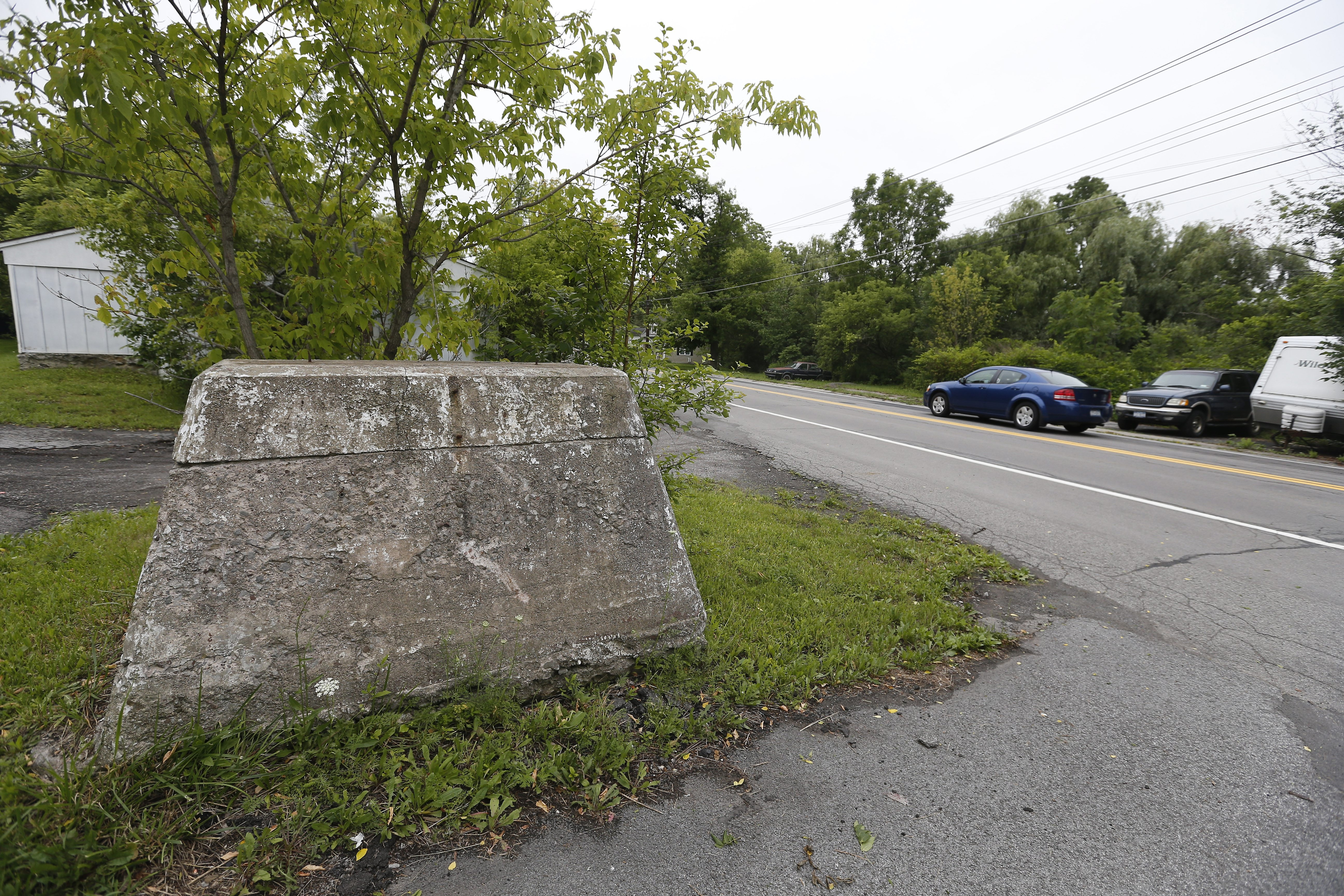 This is the stone foundation where the owl once was perched near the Rapids Fire Company in Lockport.