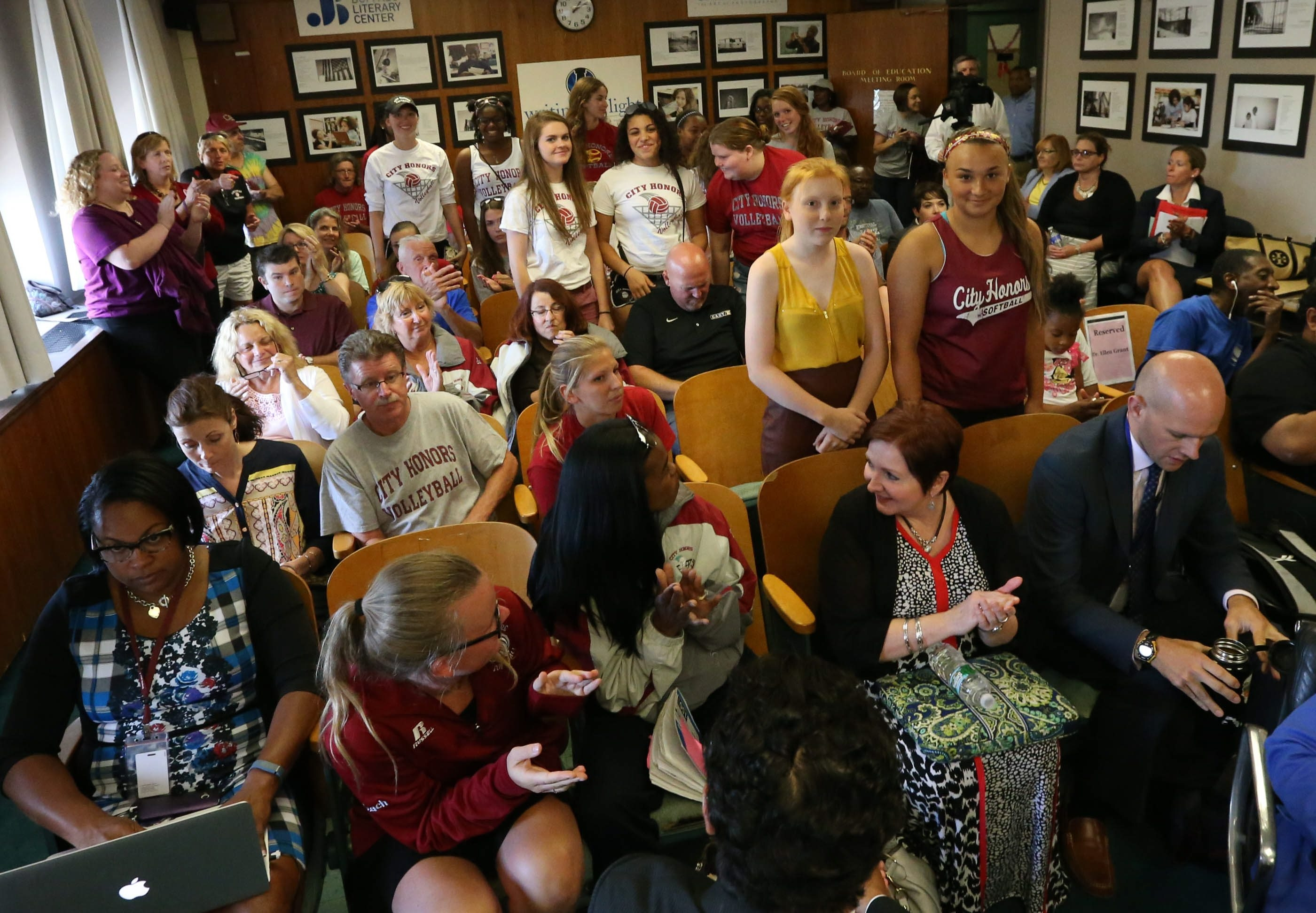 City Honors students and parents showed support for volleyball coach Deb Matos during a school board meeting at City Hall in Buffalo,NY on Tuesday, July 21, 2015.  (James P. McCoy/ Buffalo News)