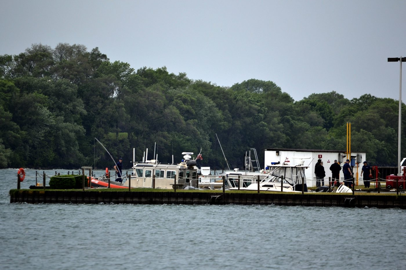 Law enforcement officials at the spot where bones were found Monday. (Larry Kensinger/Special to The News)