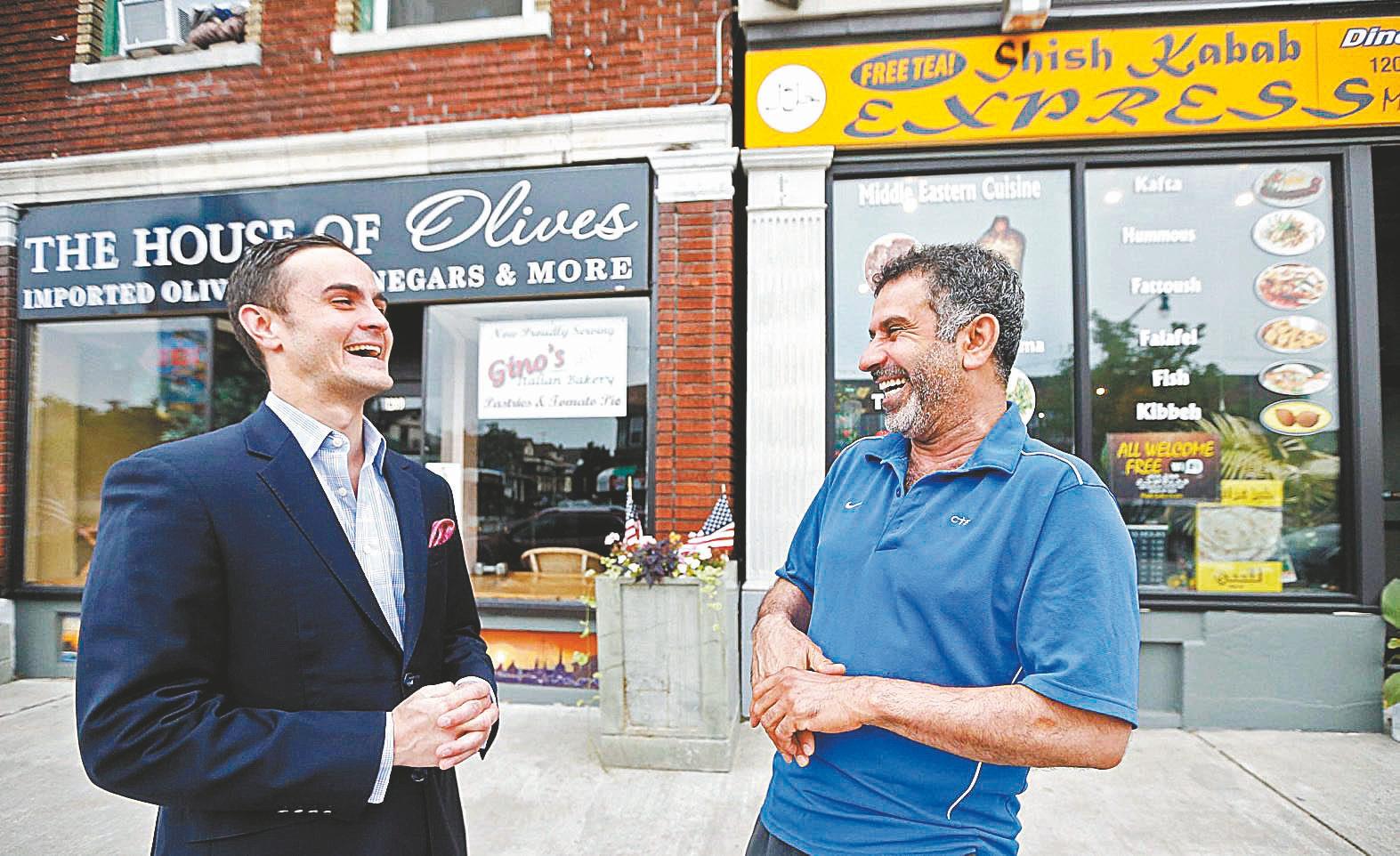 Tommy Lombardo Jr., left, of Lombardo's Ristorante, is on Hertel Avenue with Adnan Abdulsaid's Shish Kabab Express. (Robert Kirkham/Buffalo News)
