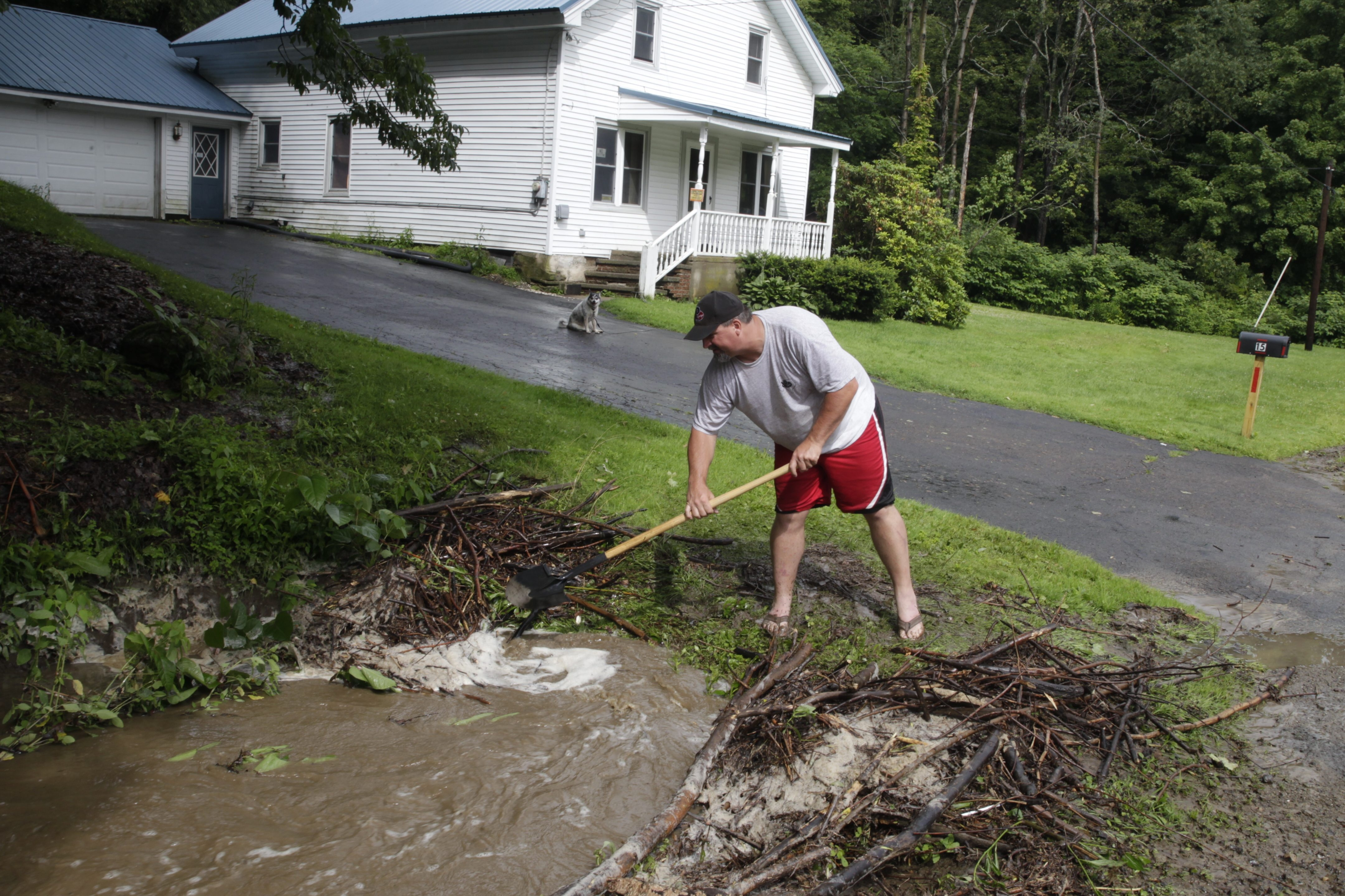 Help is available to residents who suffered damage in this week's flooding, which affected Chris Mierzwa, shown cleaning out a culvert on Frisbee Road after debris blocked it and inundated the road Tuesday in Cassadaga.