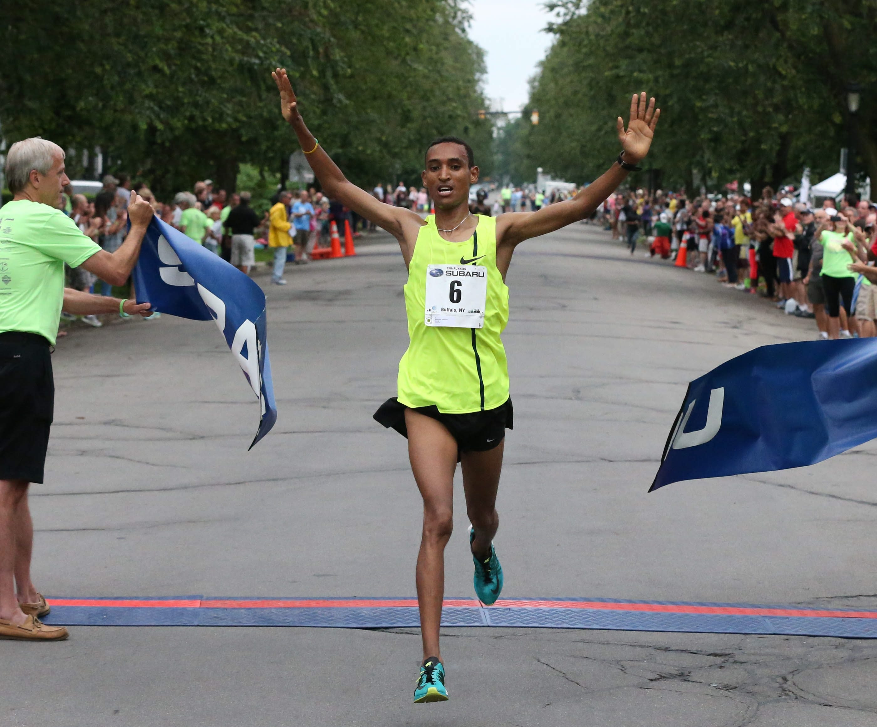 Teshome Mekeonen wins the Subaru 4-Mile Chase.  (James P. McCoy/ Buffalo News)