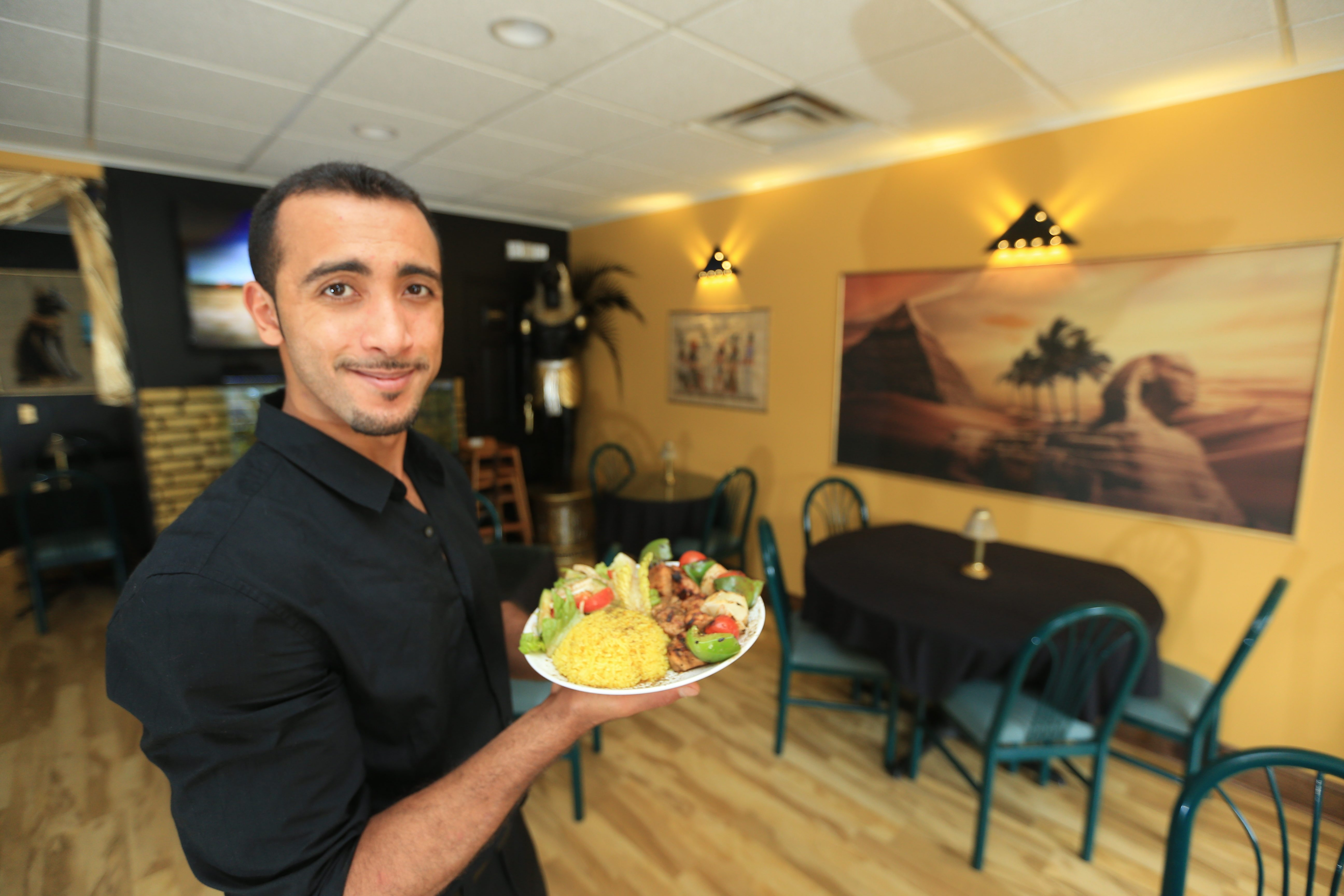 Amr Agwa, the proprietor of Pita Brothers Mediterranean Grill in Niagara Falls, serves a chicken shish kabob platter. Hummus is one of the best options at Pita Brothers, but the menu has much to offer.