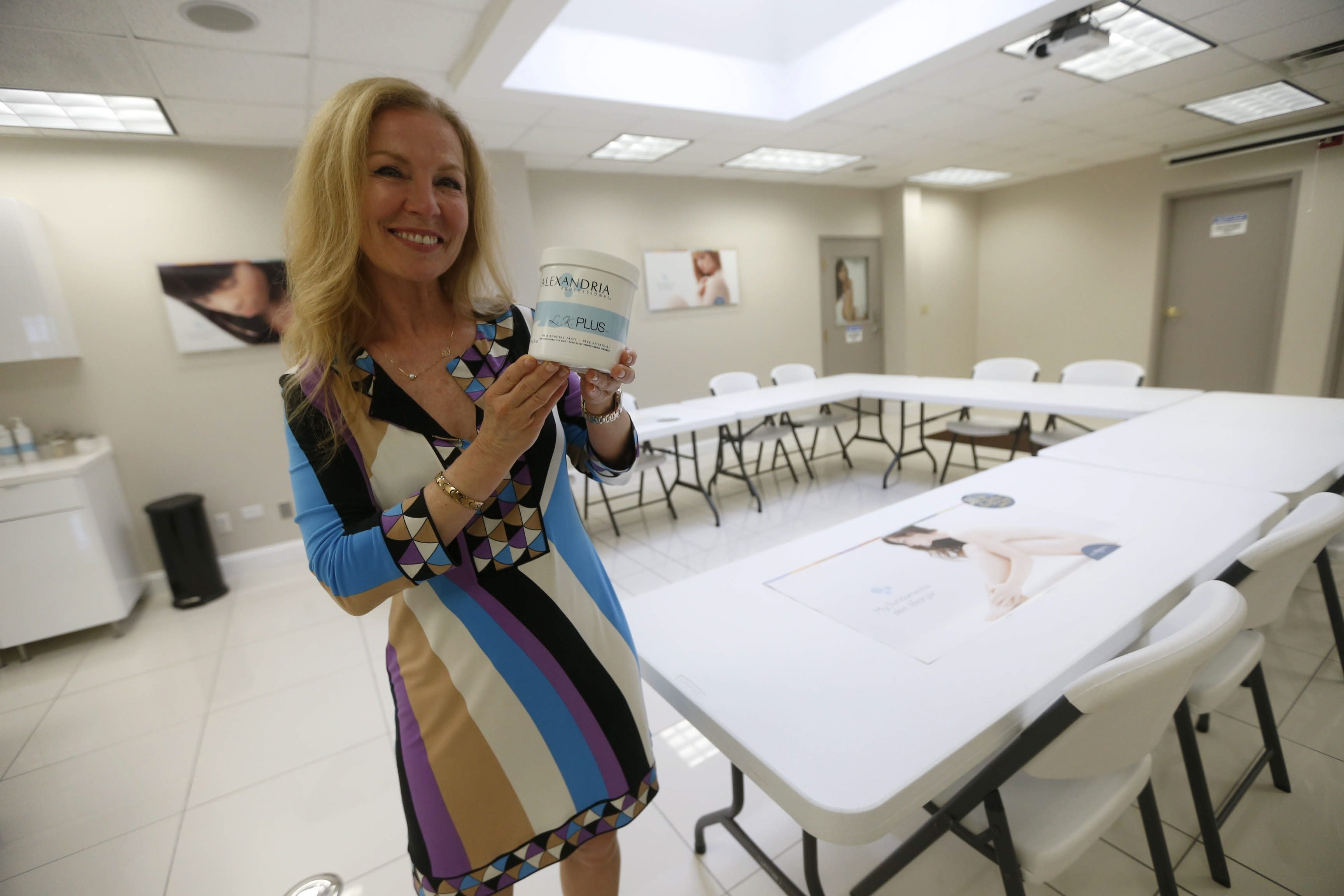 Lina Kennedy, president and CEO of Alexandria Professional, holds a tub of her sugar hair-removal formula at her Amherst facility. Though originally based out of Canada, Kennedy moved the business across the border to the Buffalo area.