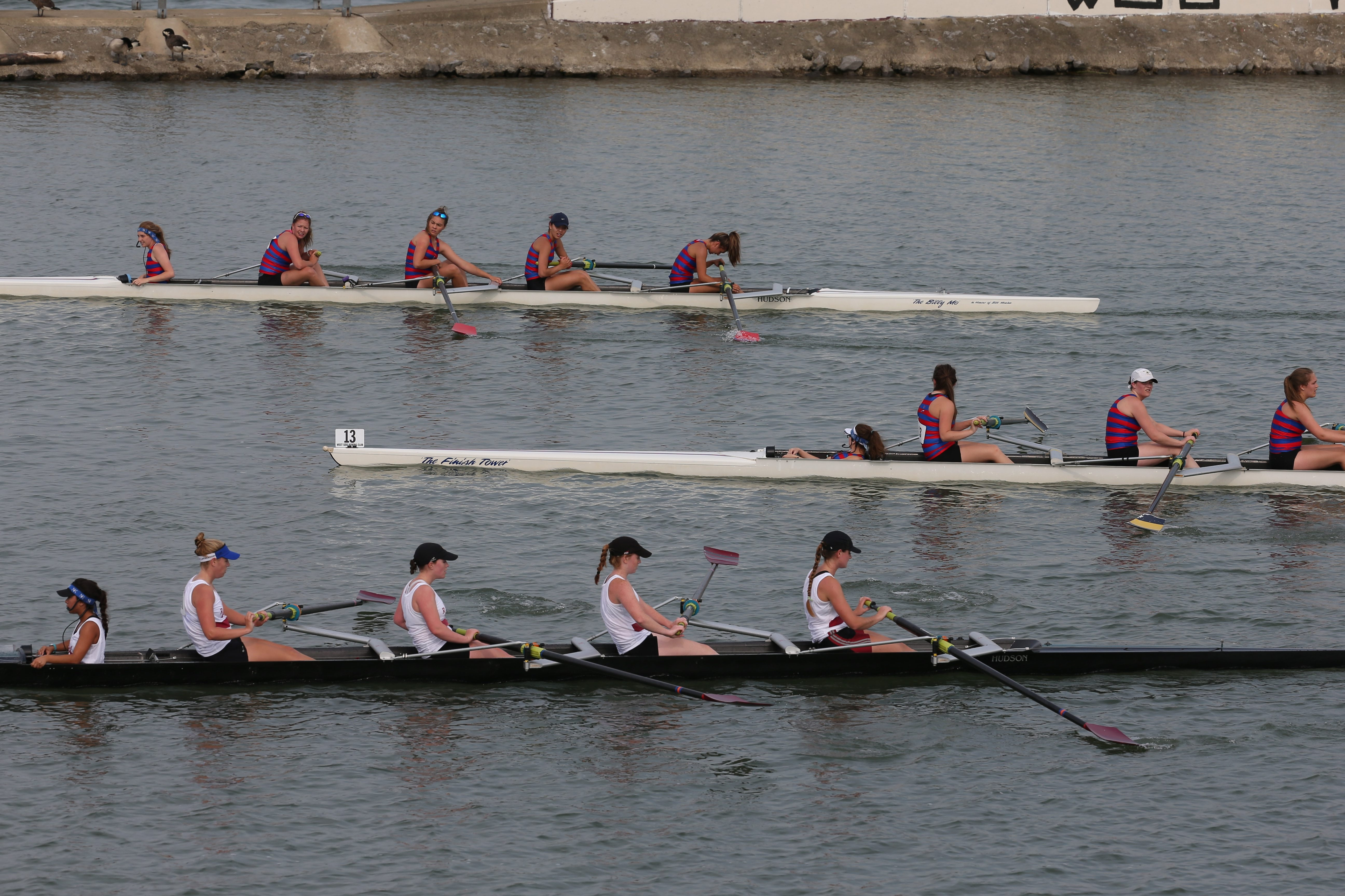 The West Side Rowing Club competes Sunday in four-oared boats during its 102nd annual Invitational Regatta.