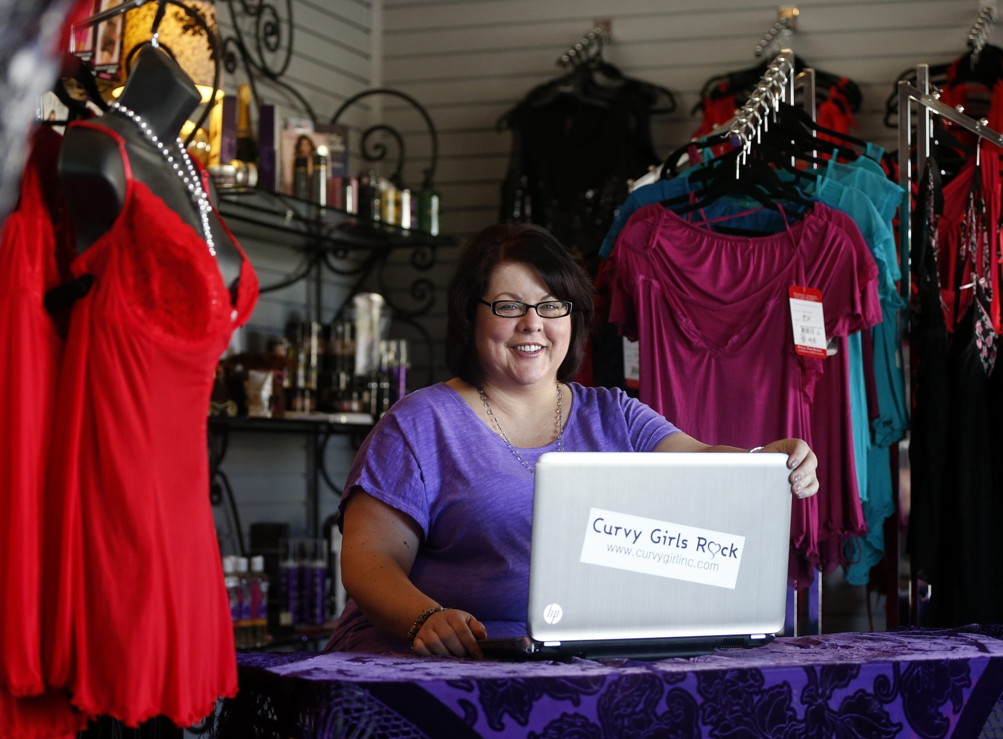 Chrystal Bougon is seen at her store Curvy Girl Lingerie in San Jose, Calif., on Monday, June 15, 2015. Small businesses like Curvy Girl Lingerie have been impacted since Facebook started limiting the number of unpaid promotional posts on its NewsFeed, which means a business' Facebook post won't be seen by everyone who likes their page. (Josie Lepe/Bay Area News Group/TNS)