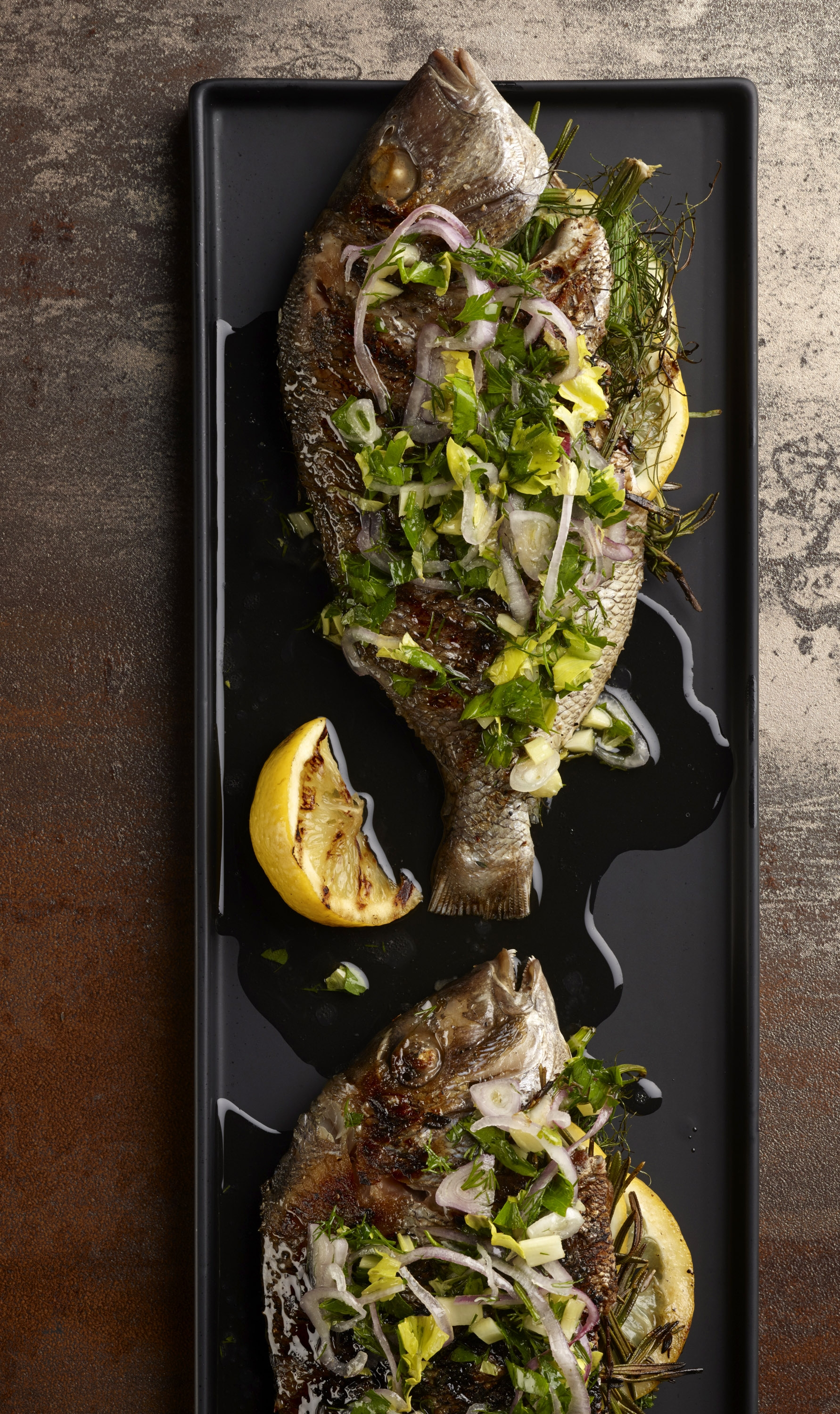 Don't let the filleting intimidate you – whole grilled fish can be enjoyed at home with this lemony Porgy Alla Salmoriglio recipe.