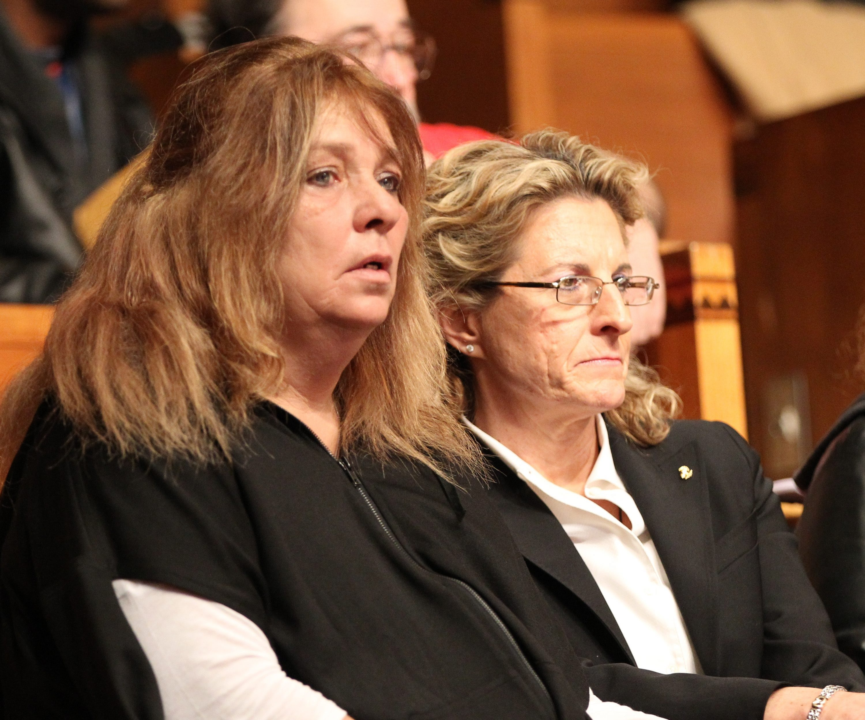 Leslie Brill, left, Amanda Wienckowski's mother, attends a special Common Council meeting about her daughter's death, held in City Hall on Jan. 29, 2013. (News file photo)