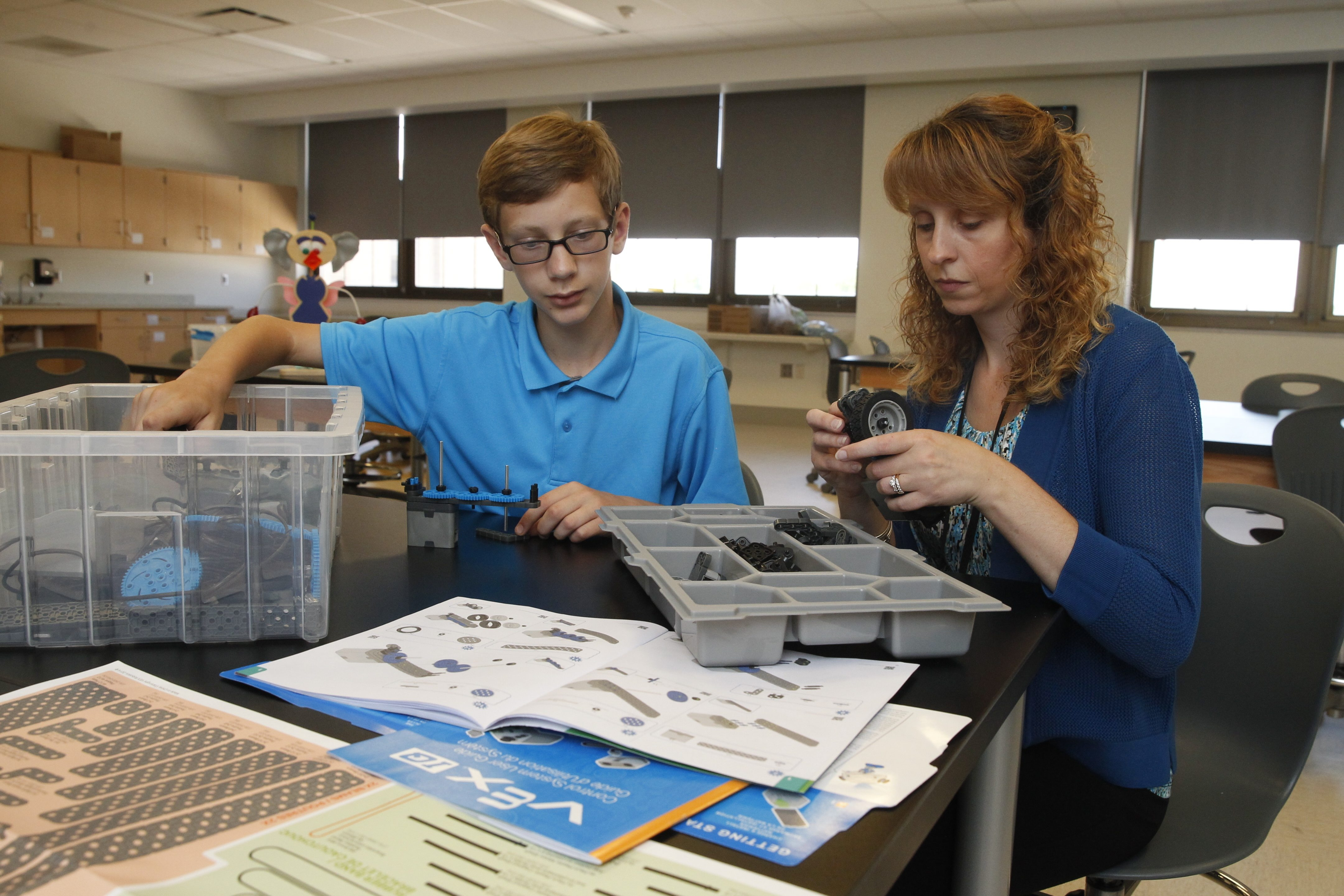 Ronni McGrath, right, works with student Jacob Mosholder, 13, on a science project at Gaskill Preparatory School in Niagara Falls. Students from three Falls schools will be participating in the Student Spaceflight Experiments Program in the fall.