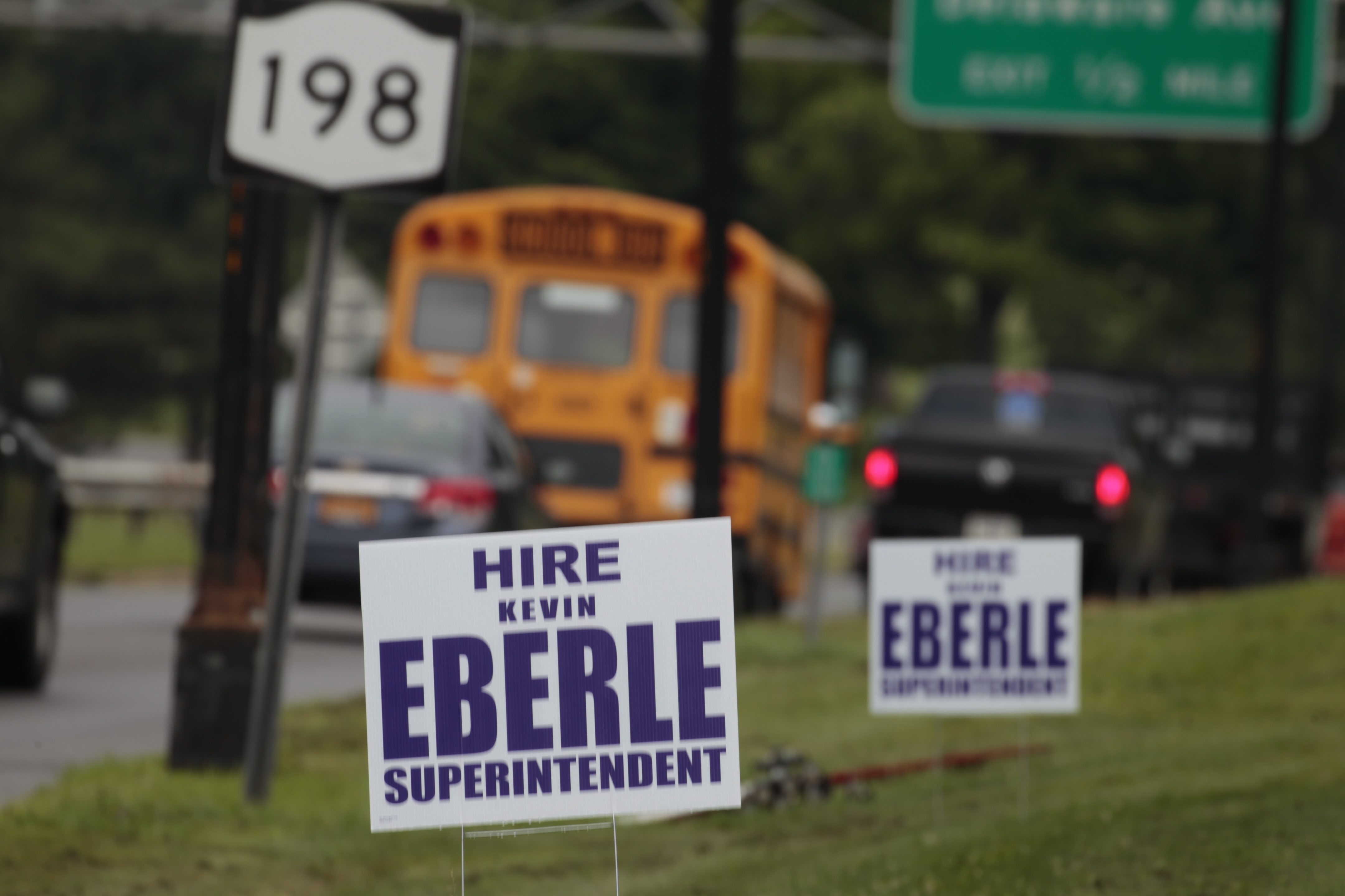 Signs like these at Parkside Avenue and Scajaquada Express- way promote Kevin J. Eberle for city school superintendent.