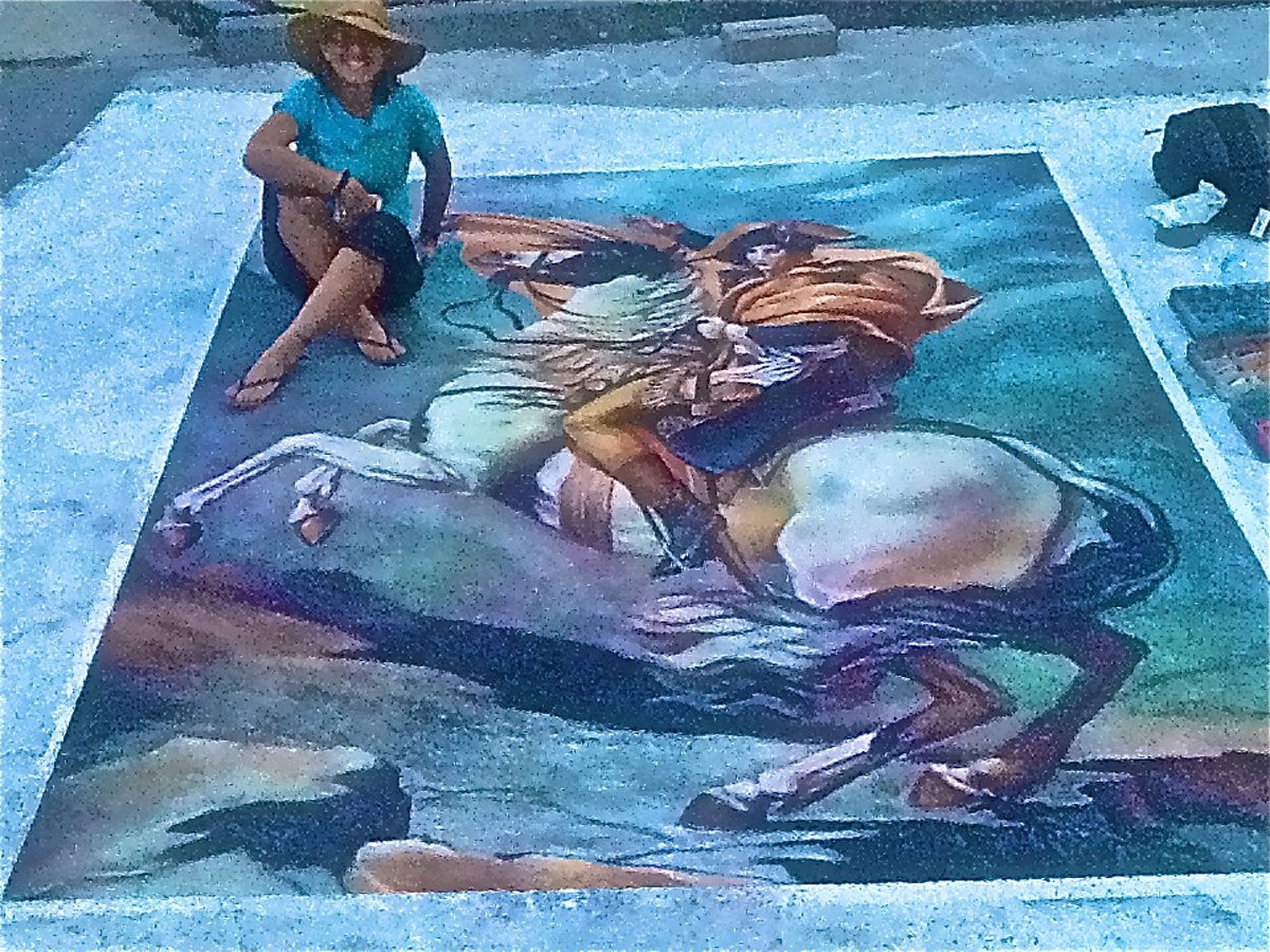 Carolyn Shultz sits by her chalk rendering of Napoleon.