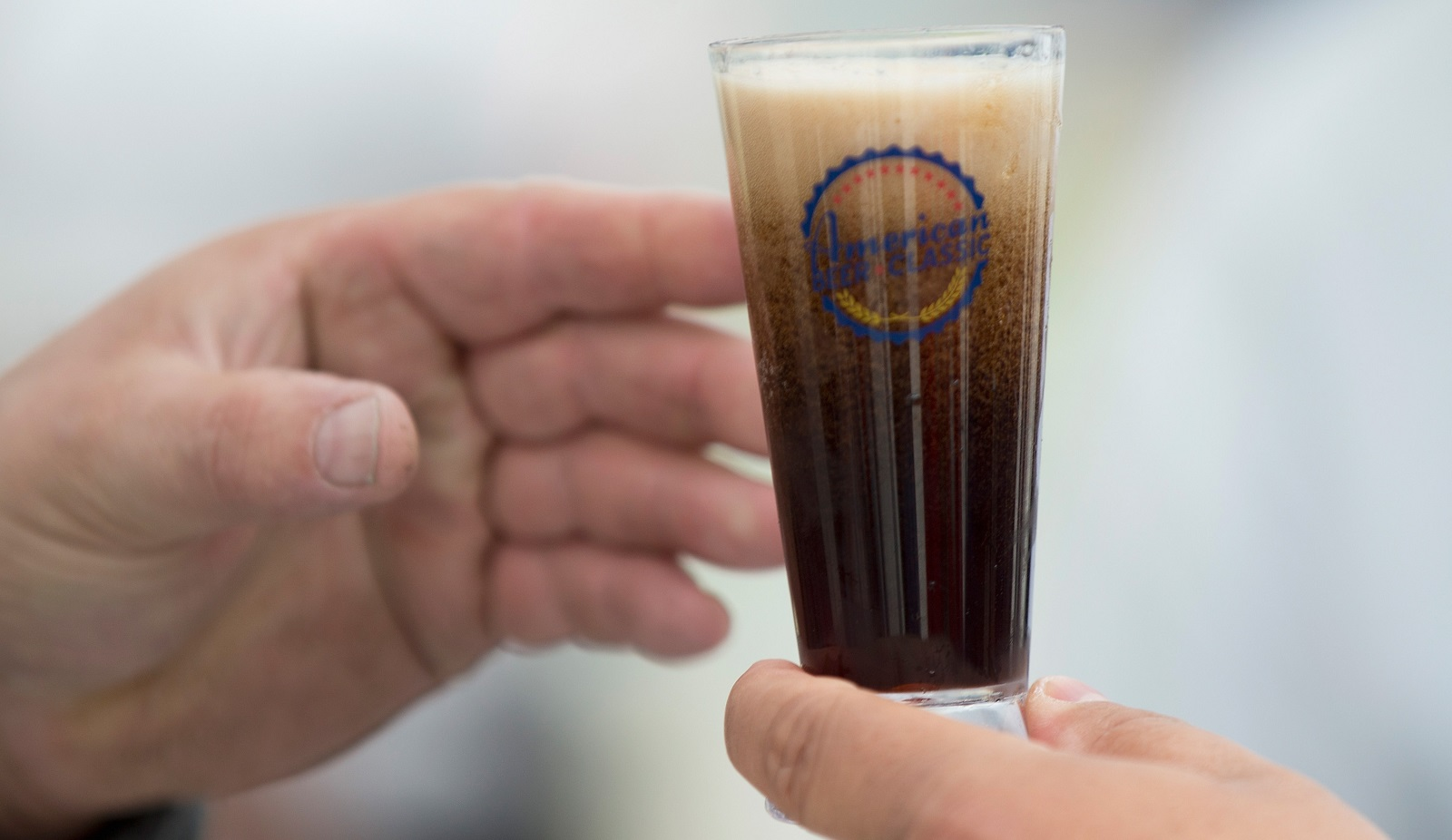 Not Your Father's Root Beer, an alcoholic beverage produced by Small Town, has been quickly selling out in area stores. Here it's pictured as a sample-sized portion in Chicago. (Getty Images)