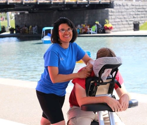 'I feel like I'm on vacation everyday,' licensed massage therapist Theresa M. Gantz says about her summre gig at Canalside. (Markenzy Julius Cesar)