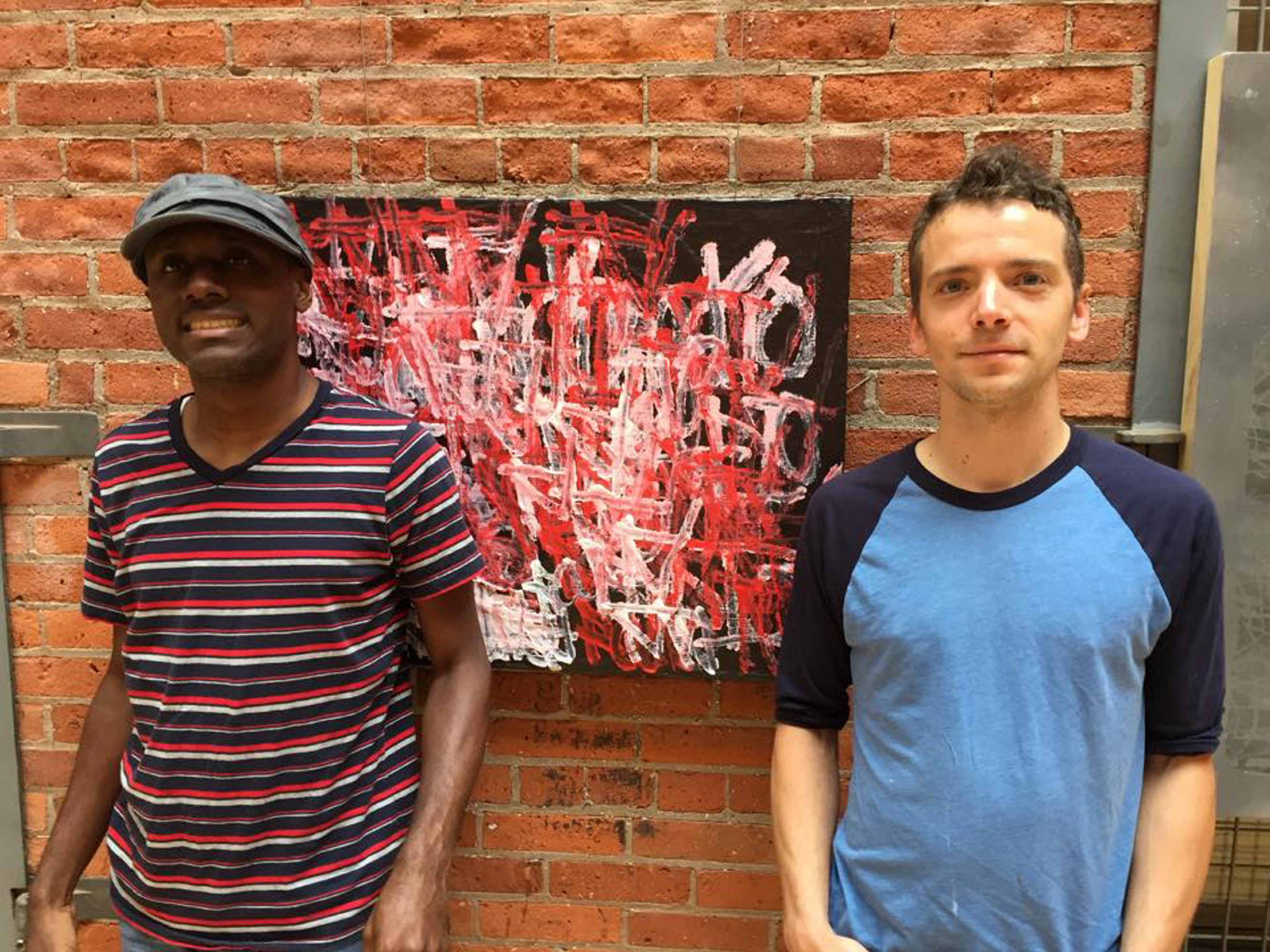 Artists Langston Gardner, left, and Kyle Butler collaborated on an art show running through Sept. 3 in Autism Services on Elmwood Avenue.