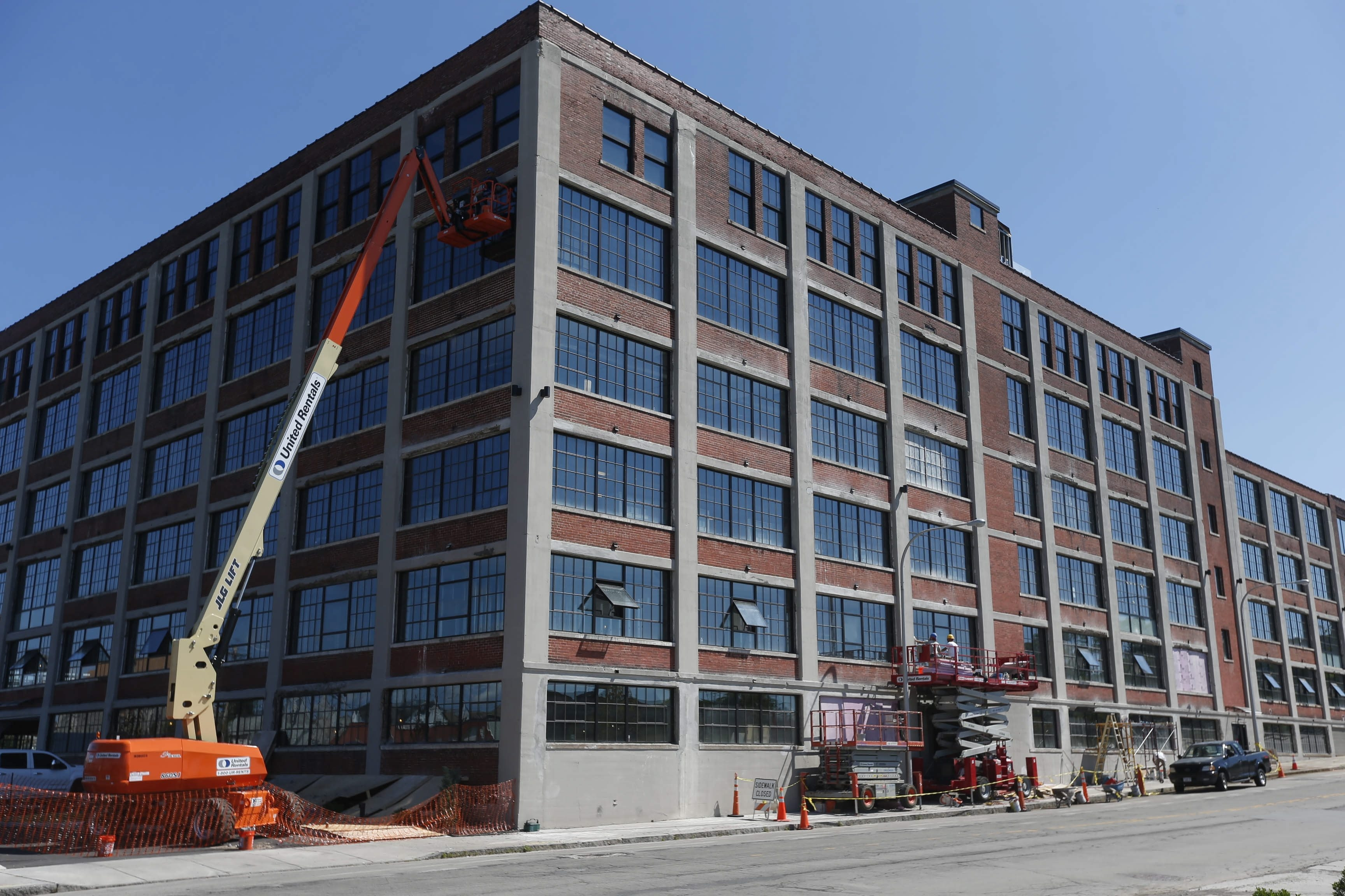 Residents of Buffalo's impoverished neighborhoods have been working for months on the redevelopment project at 500 Seneca St. as part of a new employment initiative through which they have gained experience while earning $15 an hour.