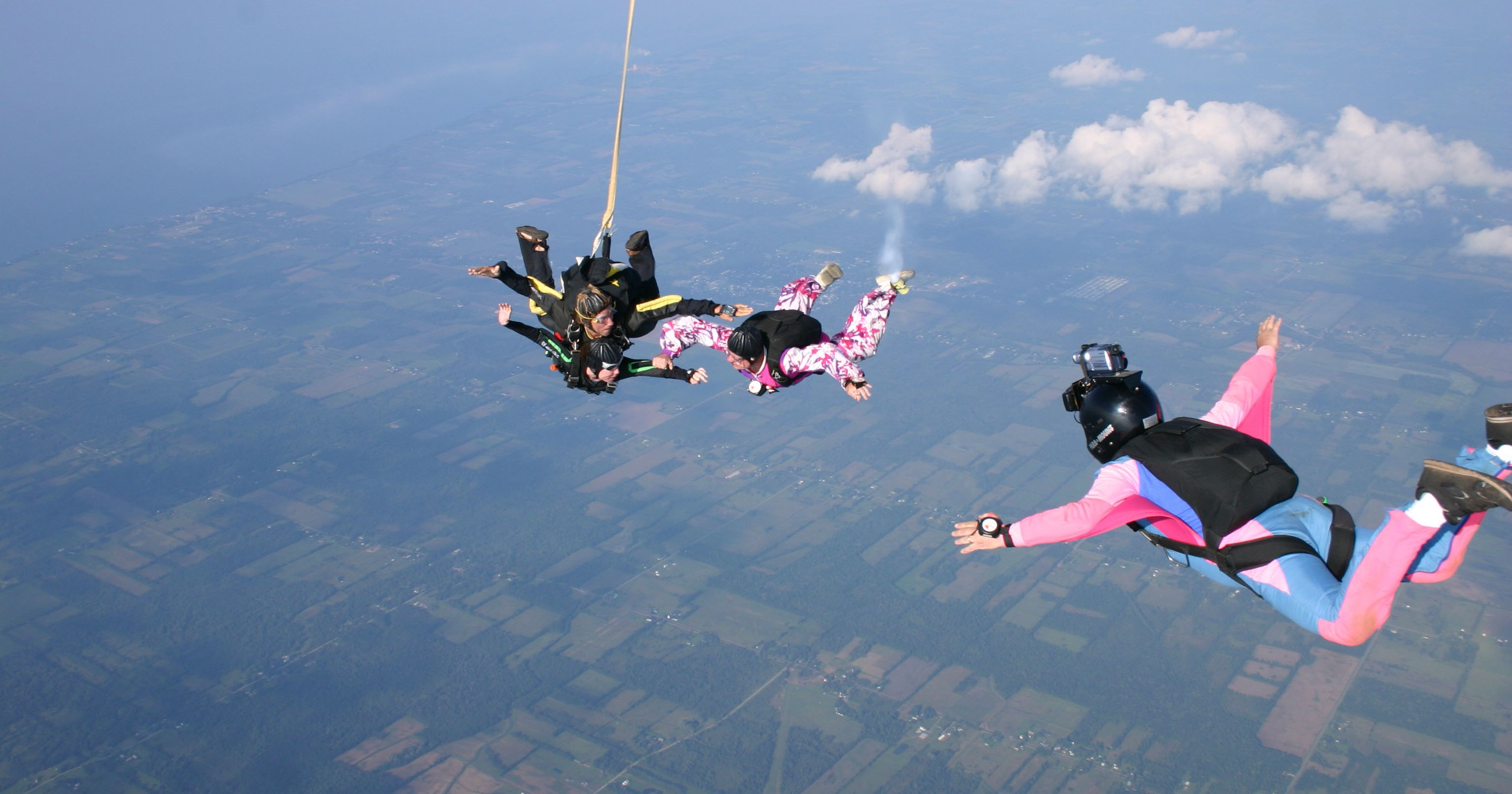 A photo provided by Frontier Skydivers shows Joe Eberhardt serving as pilot for a tandem skydive in 2004. (Jimmy Tavino/Frontier Skydivers)