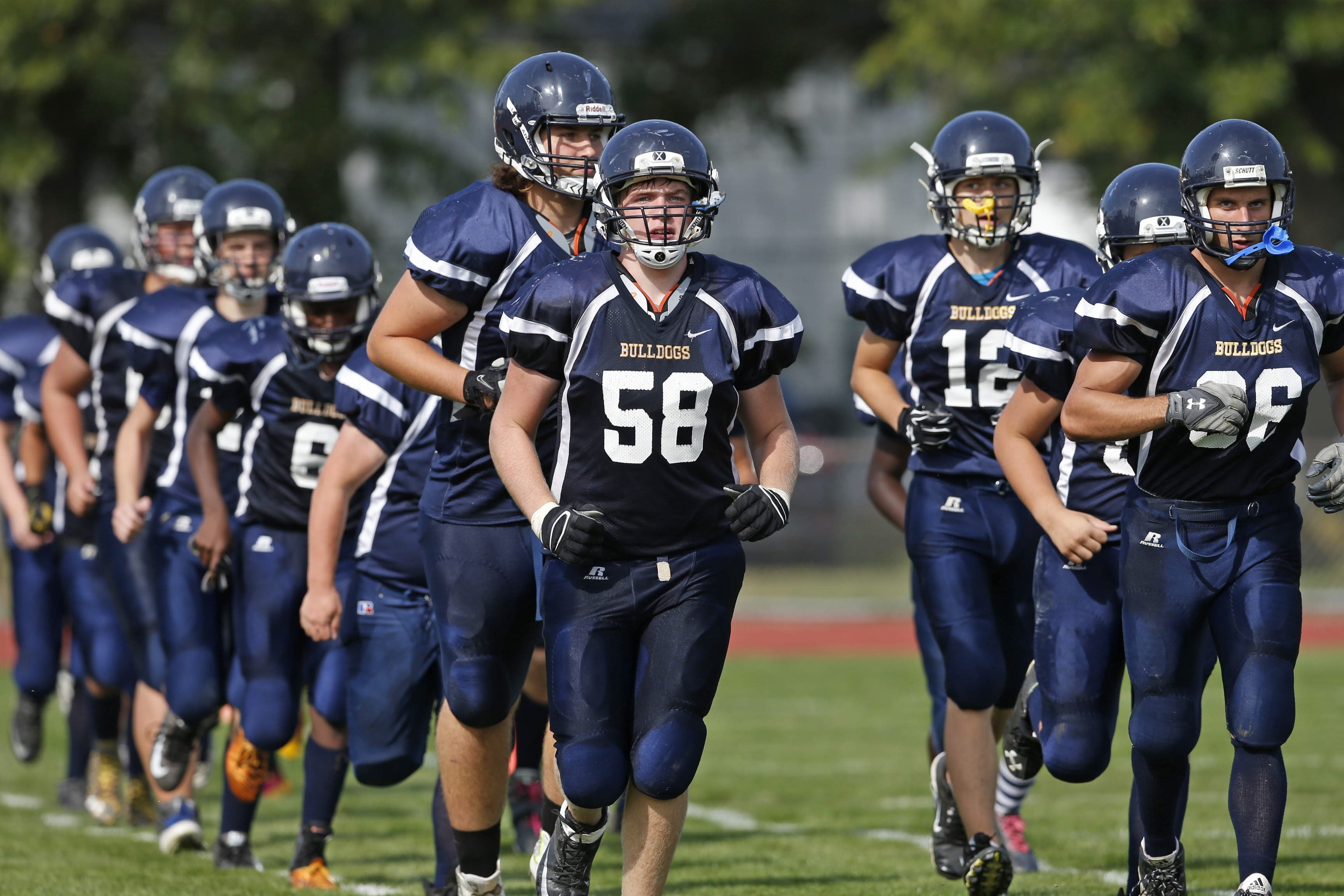 Kenmore East seniors Josh Moore (58) and Jacob Elgie (66) are fighting through a season where the numbers of players has been scarce and the team has been outscored 139-12.