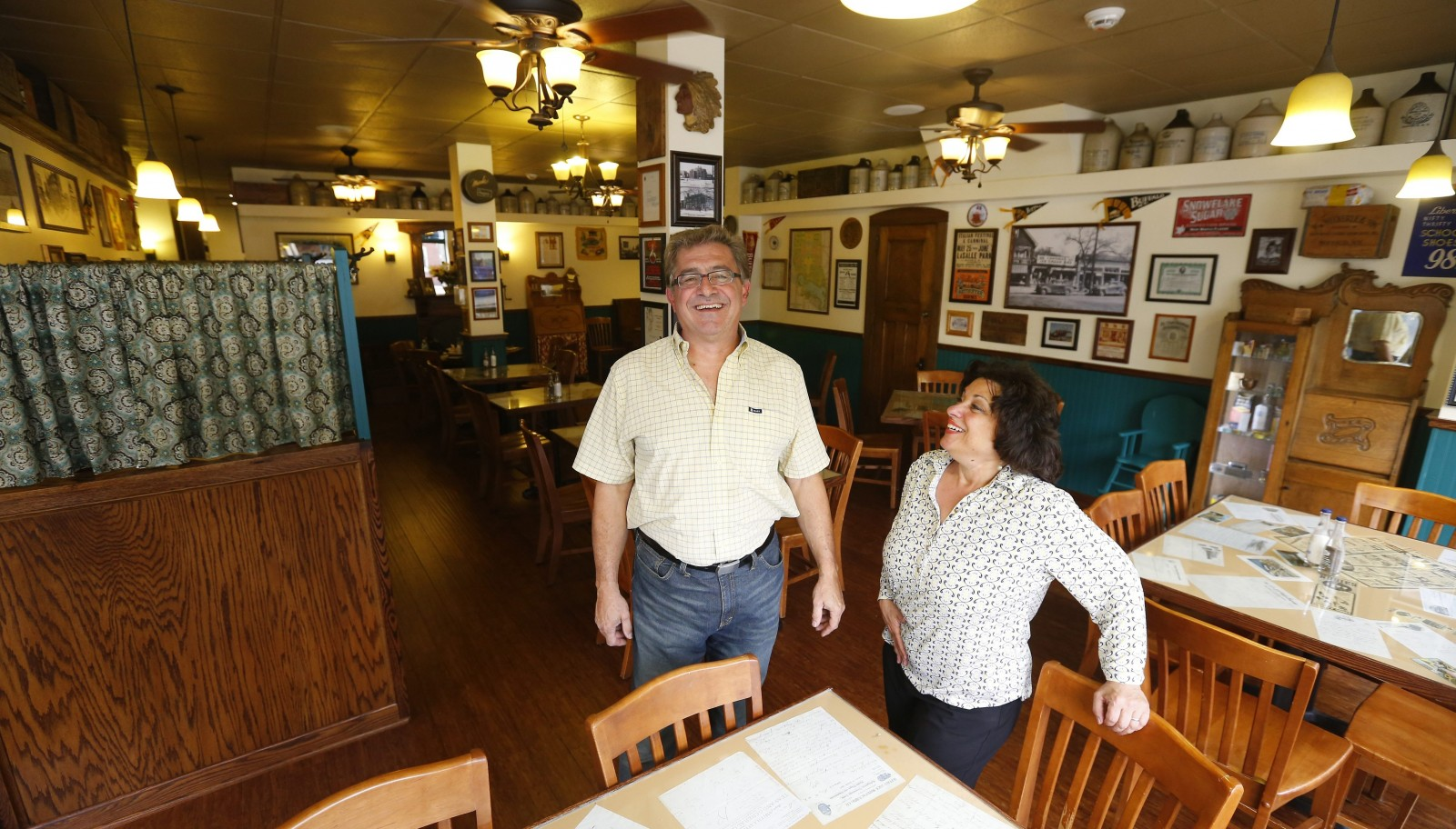 At top, Leonard Mattie and his wife Nancy Abramo show off Parkside Meadow, their new restaurant. The restaurant is decorated with elements evoking Buffalo's rich history, including the 1901 Pan-American Exposition, as well as long-departed bars and entertainment venues.