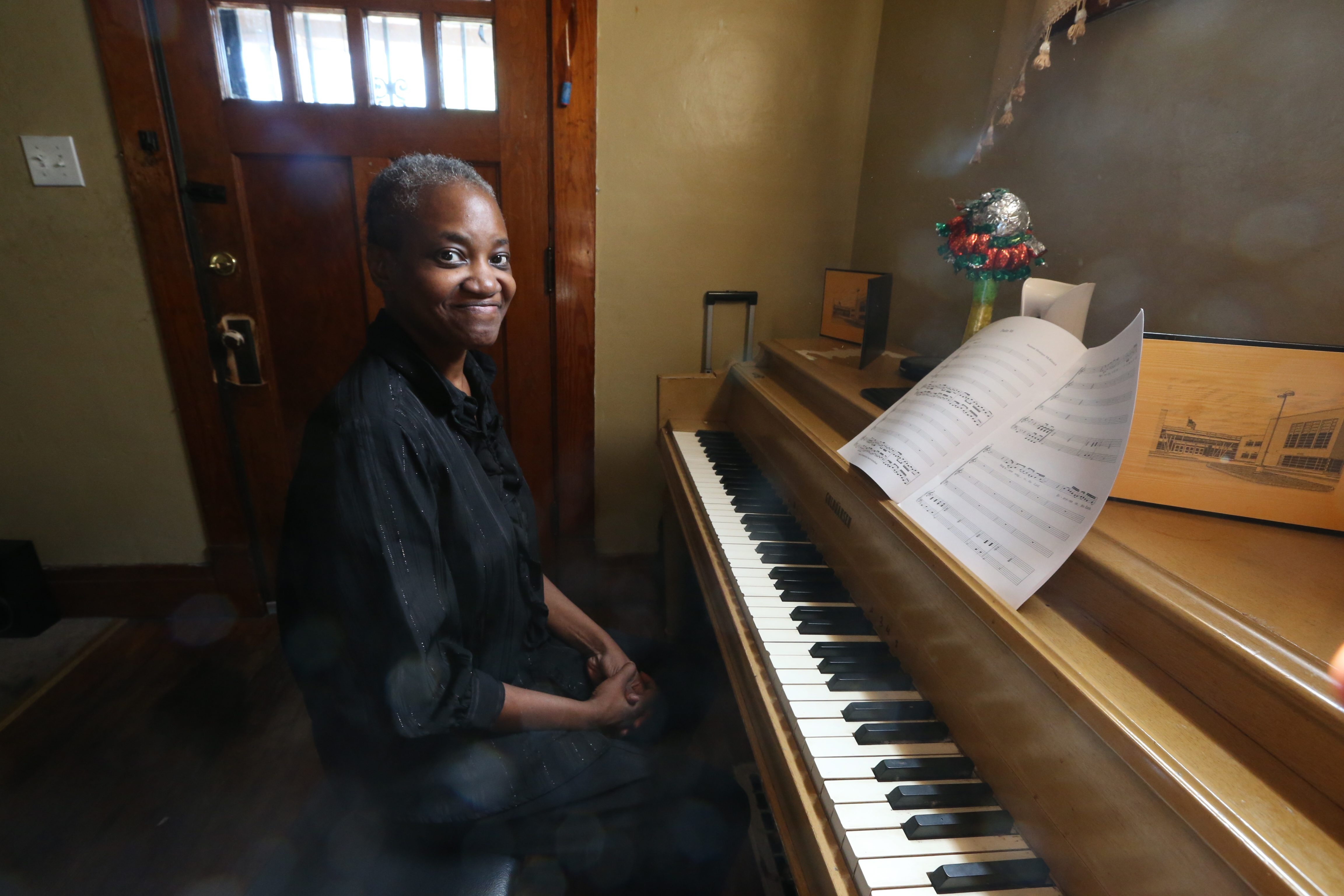 """Monique McKissick, a well-known local gospel singer, sings her """"Psalm 96"""" at  her home in Buffalo on Thursday. McKissick, who has Stage IV cancer, will be the beneficiary of a Gospel Fest Cancer Benefit on Saturday.    """"I want Monique to see the love and support this community has for her.""""  – Nicole Campfield, president of NCamped Ministries"""