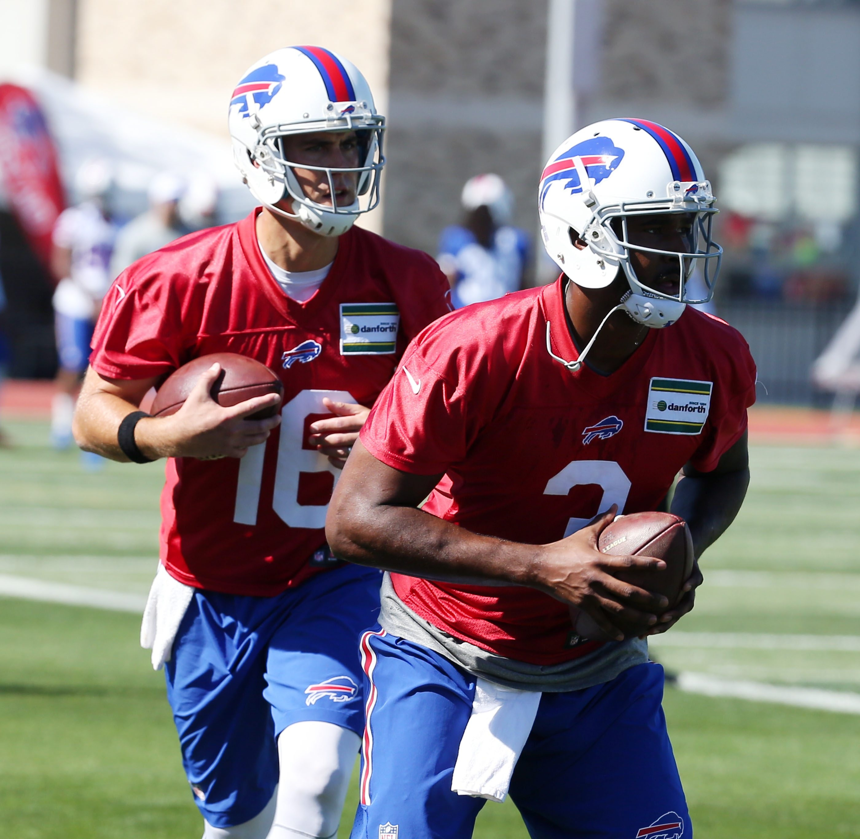 Buffalo Bills quarterback Matt Cassel (16) and Buffalo Bills quarterback EJ Manuel (3) work on their footwork during a drill on the first day of training camp at St. John Fisher College in Pittsford,NY on Friday, July 31, 2015.  (James P. McCoy/ Buffalo News)