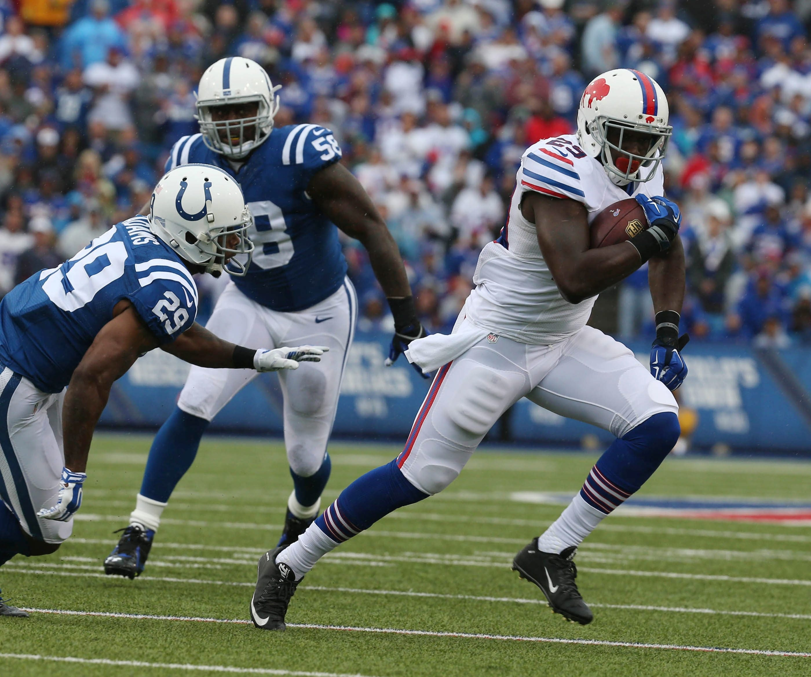 Buffalo Bills running back Karlos Williams bursts through Colts tacklers en route to his first NFL touchdown last Sunday.  (James P. McCoy/ Buffalo News)