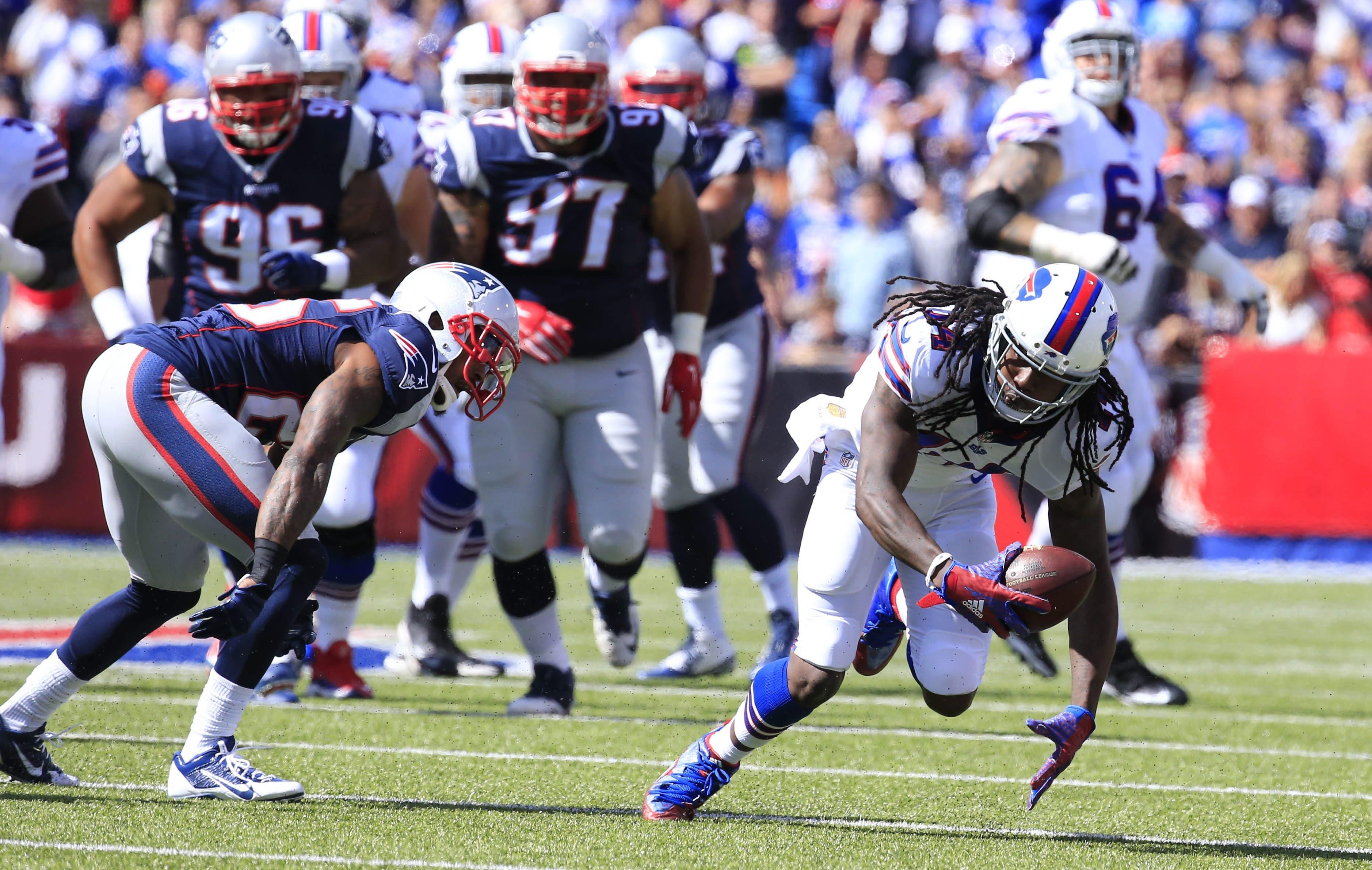 2LINE CUTLINE Buffalo Bills wide receiver Sammy Watkins picks up a pass against New England Patriots during the first quarter at Ralph Wilson Stadium on Sunday, Sept. 20, 2015. (Harry Scull Jr./Buffalo News)