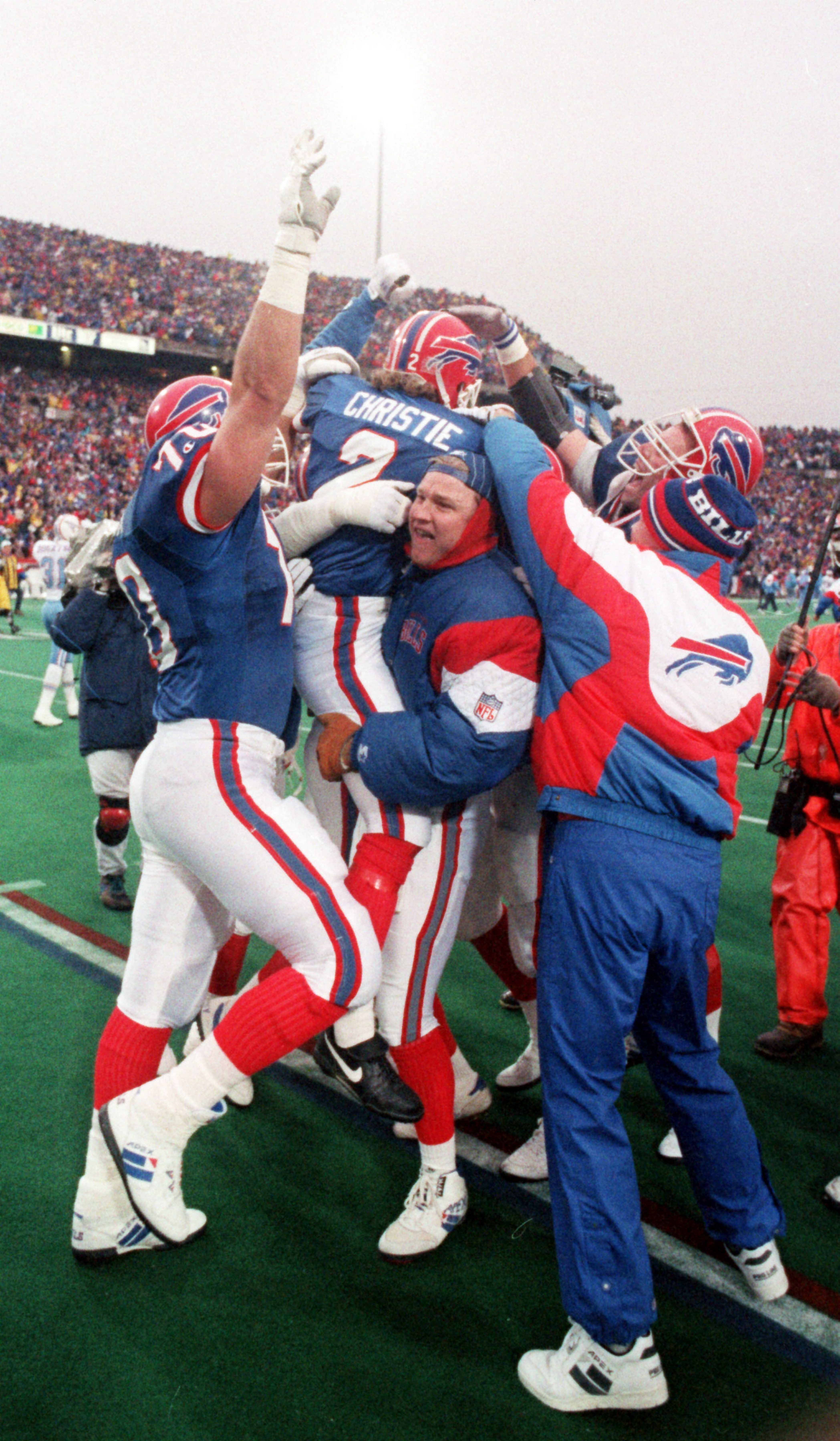 Kicker Steve Christie is mobbed by teammates after his field goal against the Houston Oilers on Jan. 3, 1993, capped the NFL's greatest comeback.