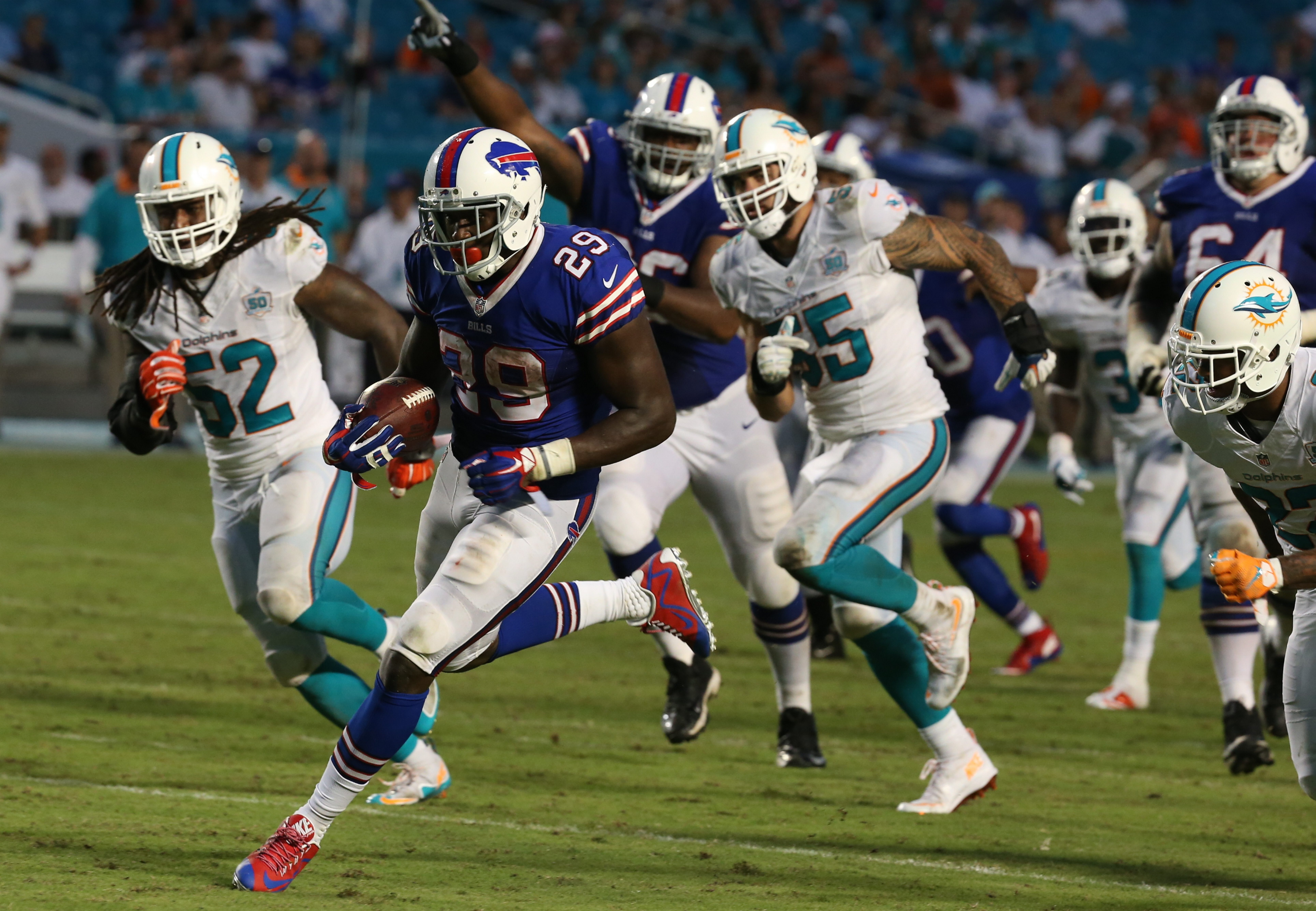 Bills running back Karlos Williams breaks through the Dolphins defense for a touchdown during the fourth quarter of the Bills' first meeting with Miami at Sun Life Stadium.