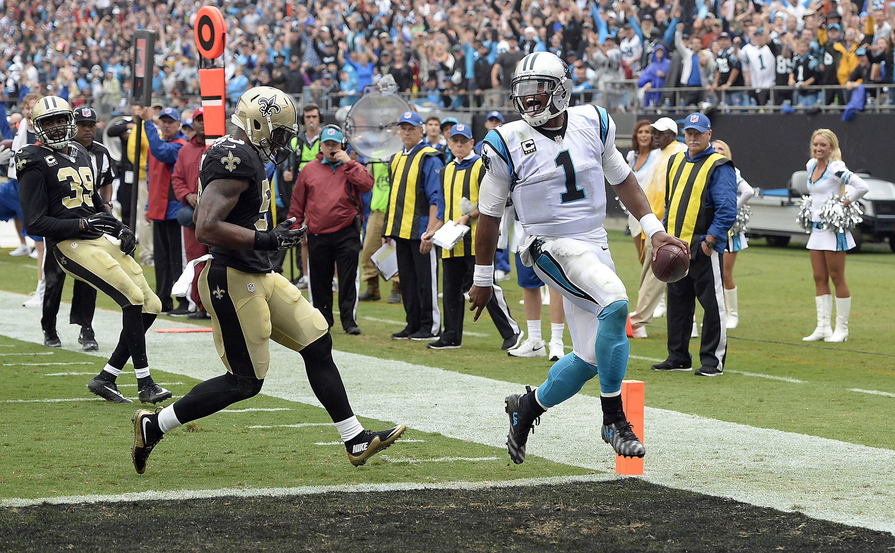 Carolina Panthers quarterback Cam Newton runs for a 13-yard touchdown that proved to be the winning points against New Orleans.