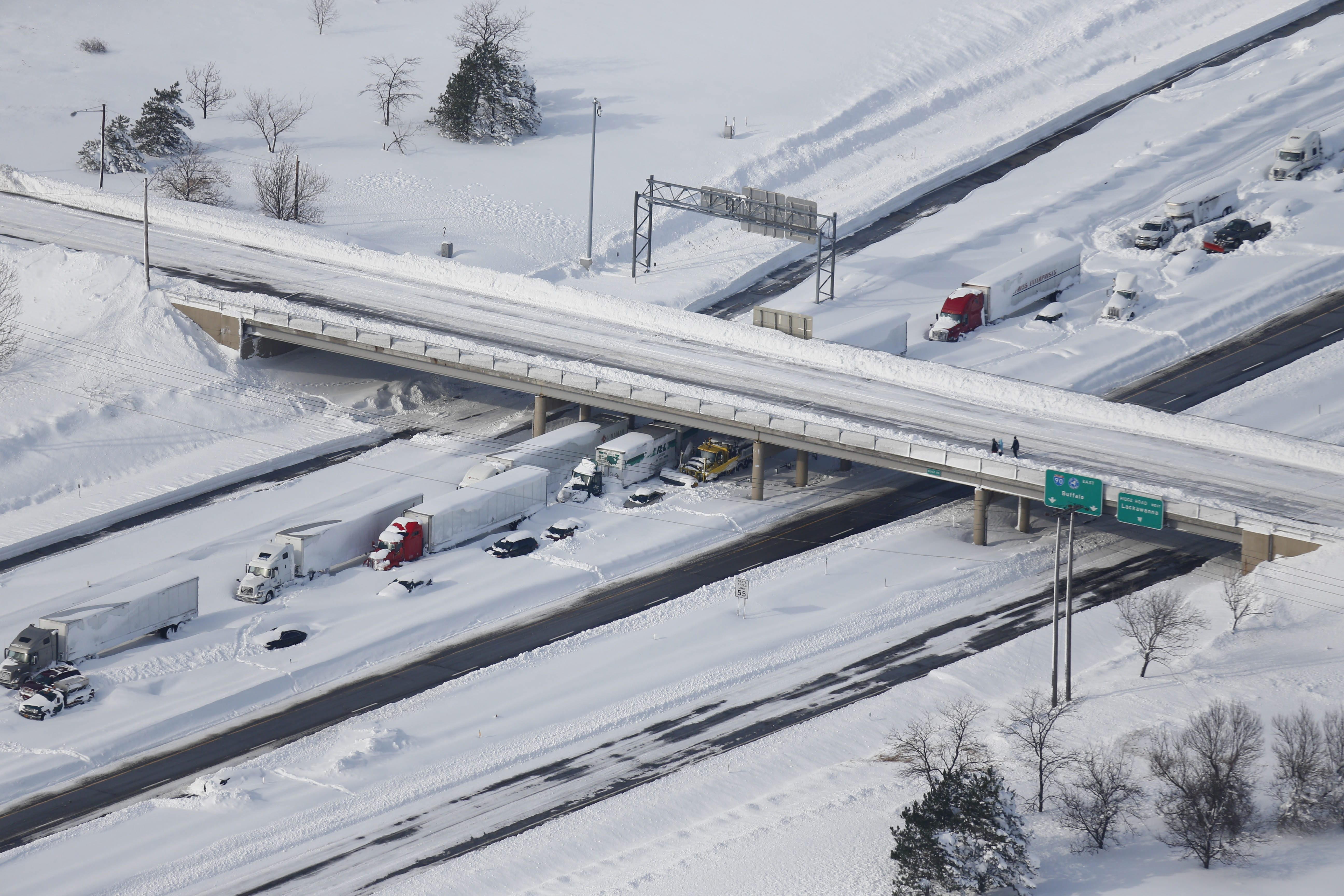 File photo from last year's November storms shows crews working to free motorists stranded on the New York State Thruway near Ridge Road.   (Derek Gee/Buffalo News)