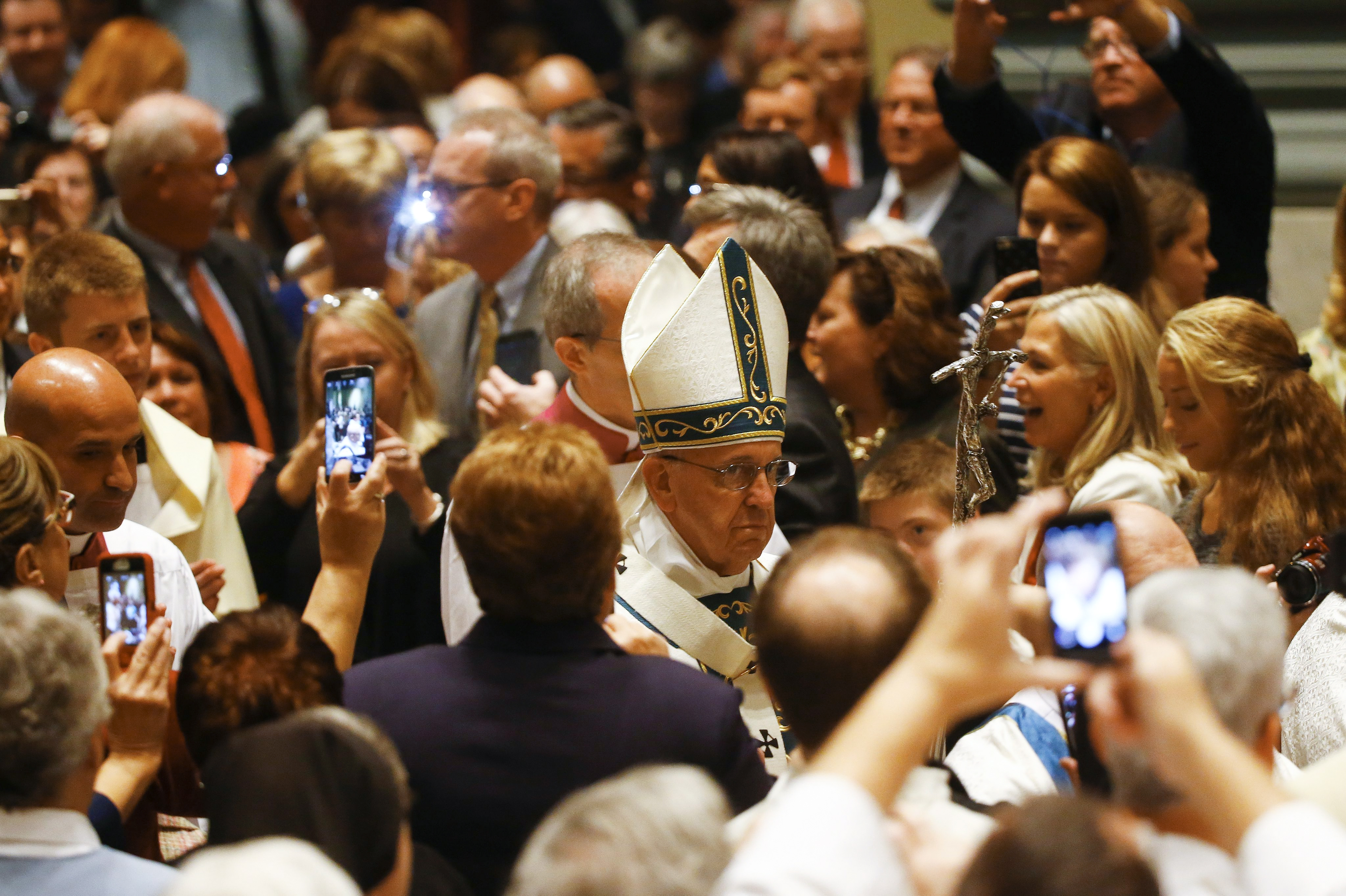 Pope Francis walks through a crowd of attendees during a celebration of Mass at the Cathedral Basilica of SS. Peter and Paul in Philadelphia, Sept. 26, 2015. Arriving in Philadelphia Saturday on the final leg of a visit to the U.S., Francis also was expected to speak at Independence Hall and attend the World Meeting of Families, a triennial gathering of Catholic families started by Pope John Paul II in 1994. (Tony Gentile/Pool via The New York Times)