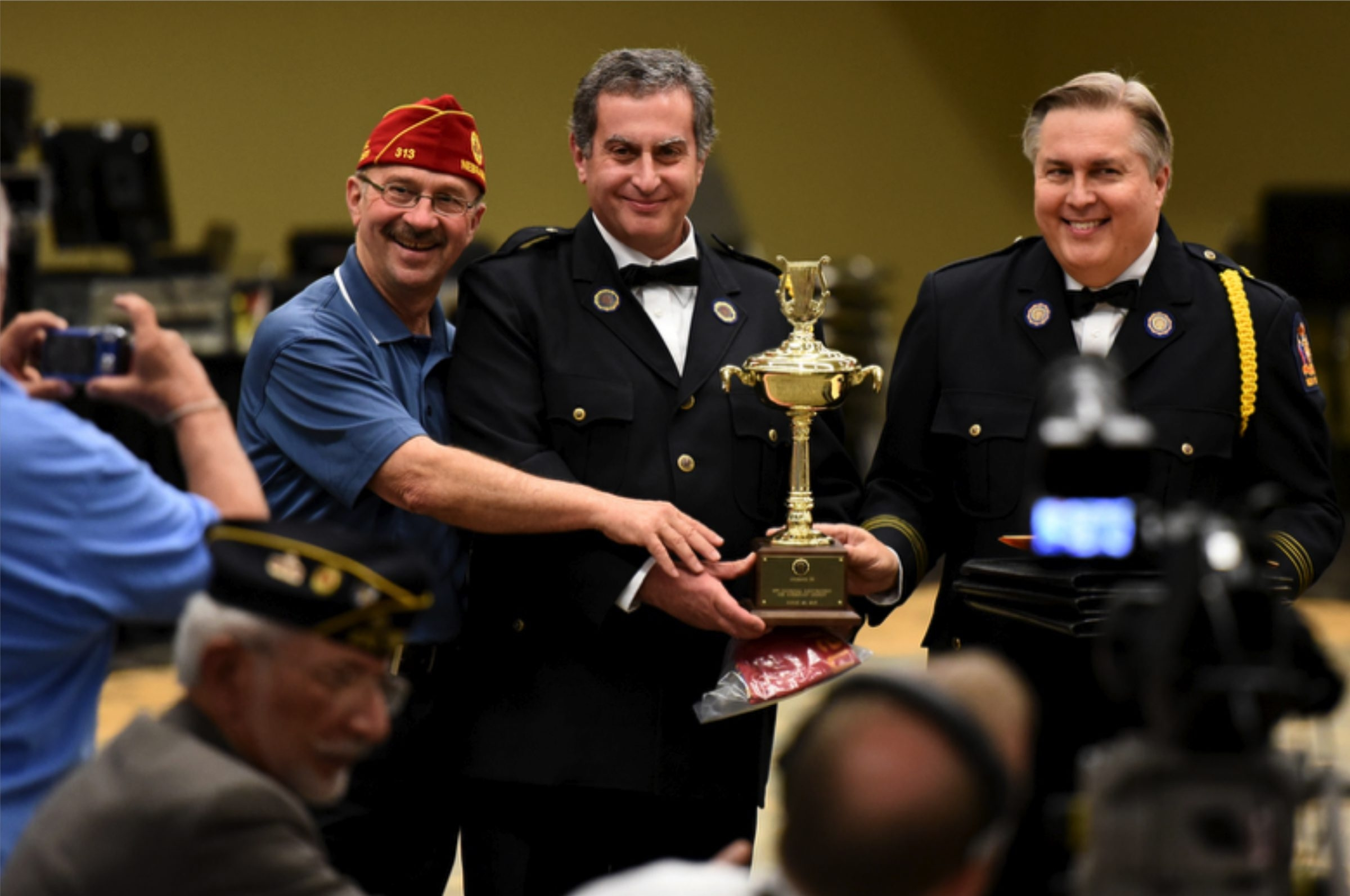 American Legion Band of the Tonawandas president David Abrahamian, center, and music director Michael Shaw are shown with National Commander Michael D. Helm, left.
