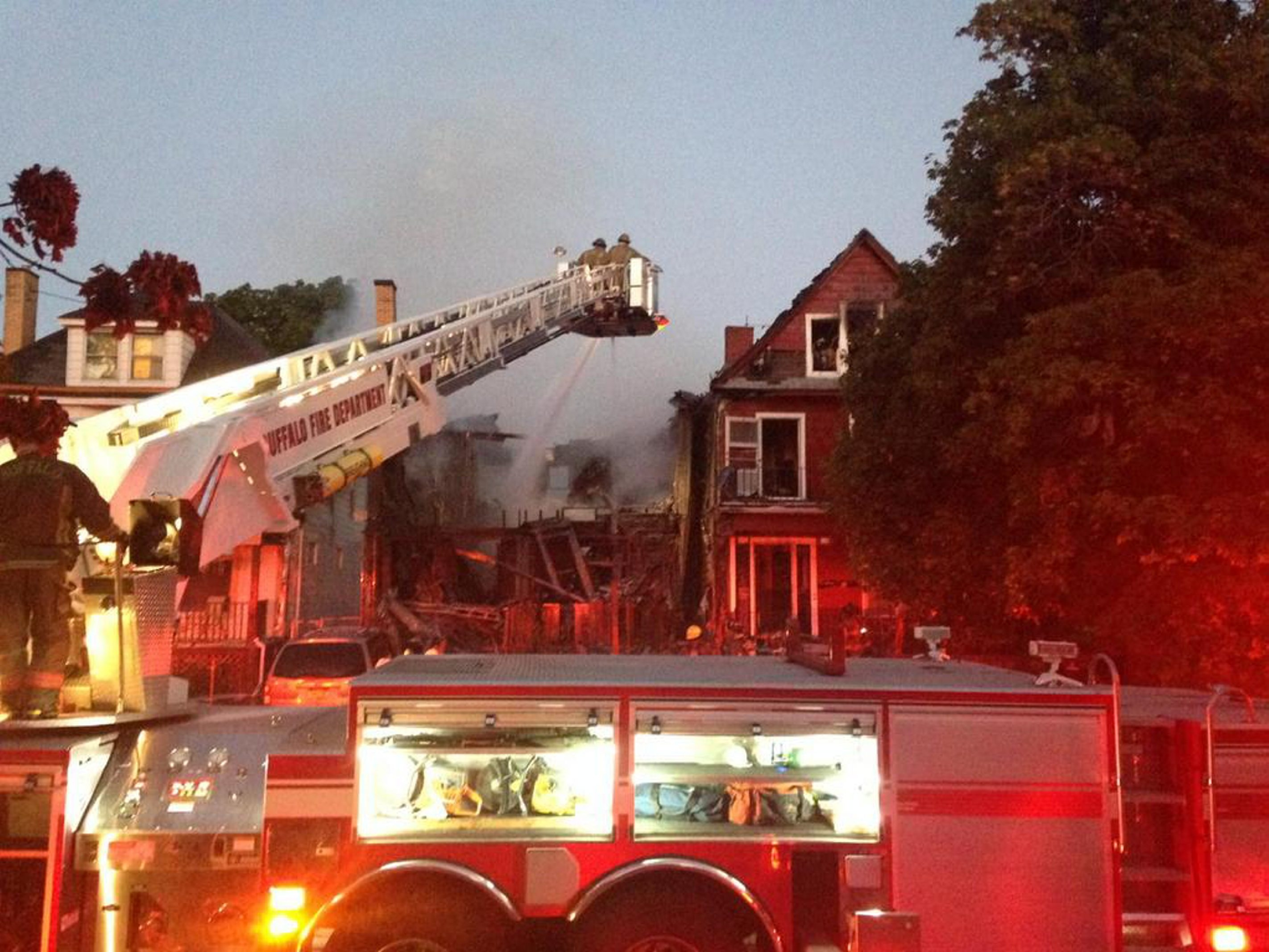 Firefighters on the scene of an early morning fire on Herkimer Street on Buffalo's West Side. (John Hickey/Buffalo News)