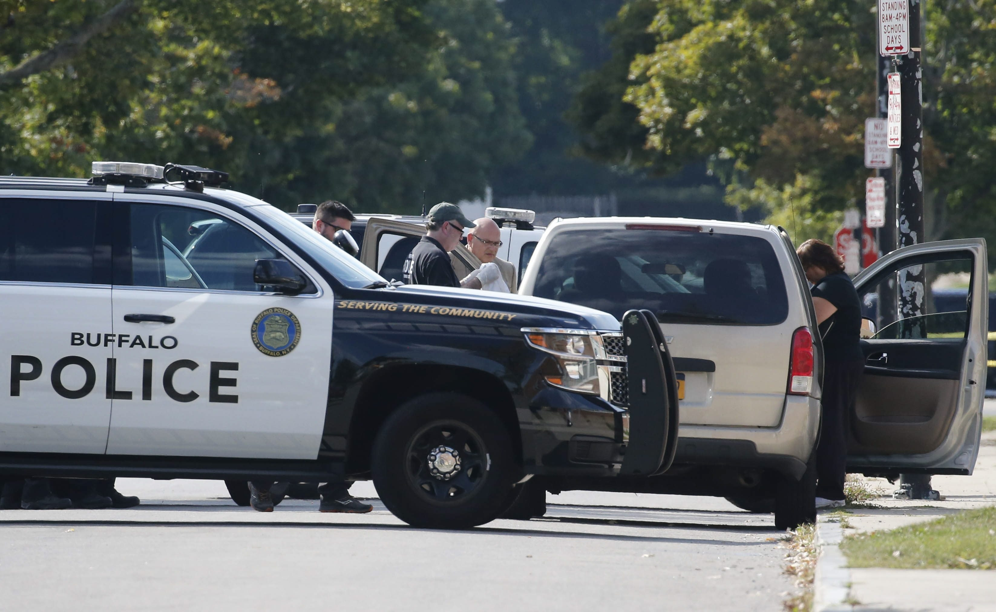 Buffalo police used patrol cars to shield the scene of a homicide on Woodlawn Avenue outside Buffalo Academy of Visual and Performing Arts on Thursday.