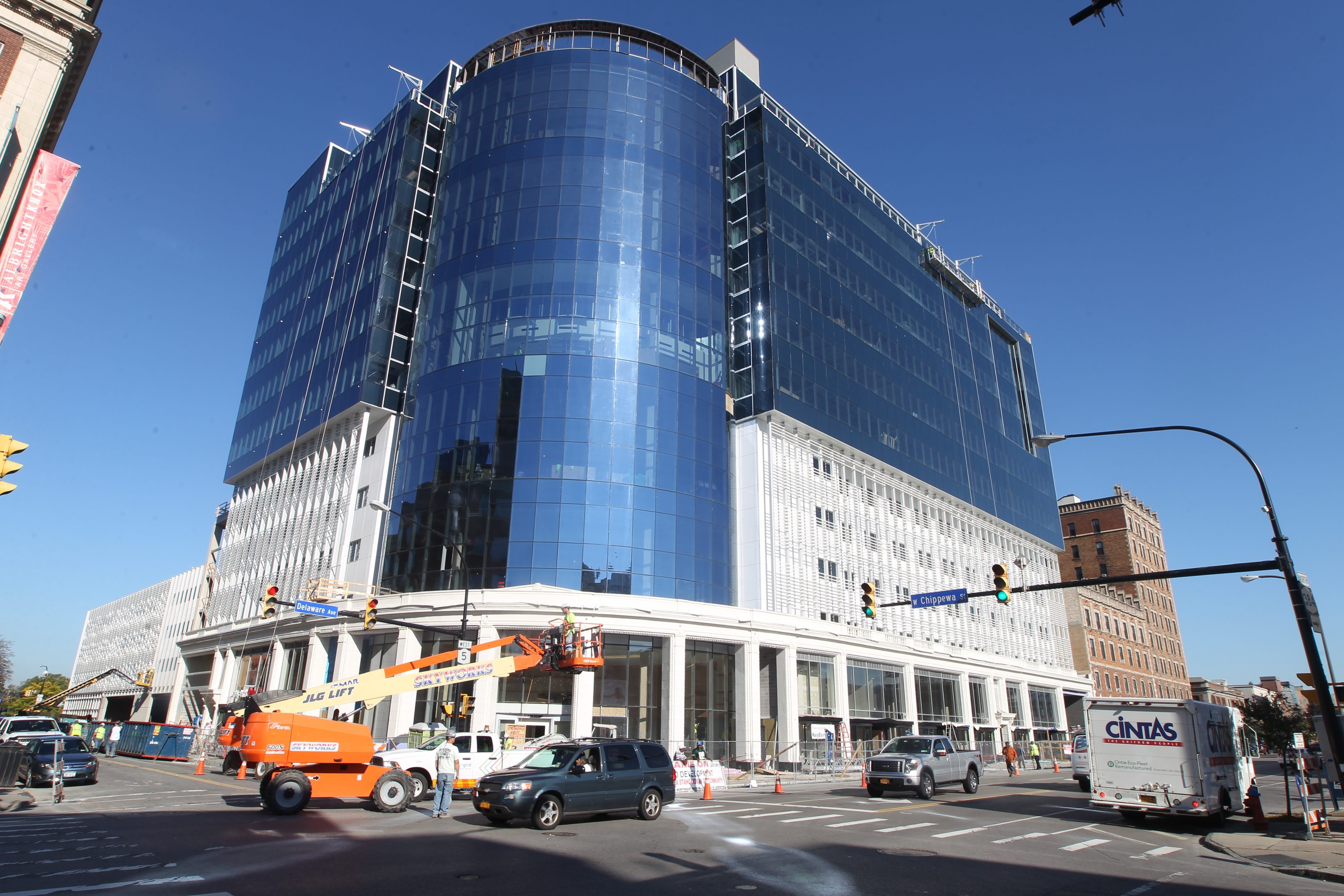Work continues Wednesday at the Delaware North headquarters building going up at Delaware Avenue and Chippewa Street. KeyBank announced plans to move its administrative offices and branch bank to the new building on Nov. 9.