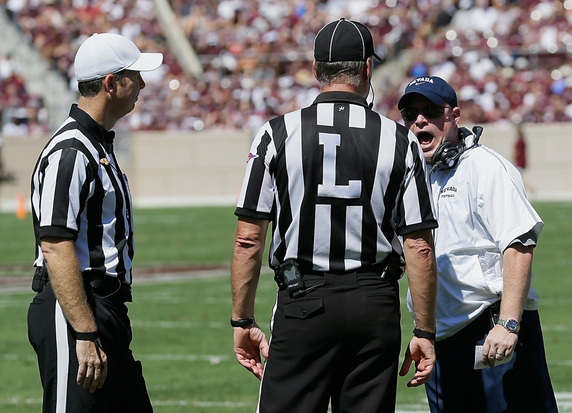 Nevada coach Brian Polian has words with an official during Saturday's loss.