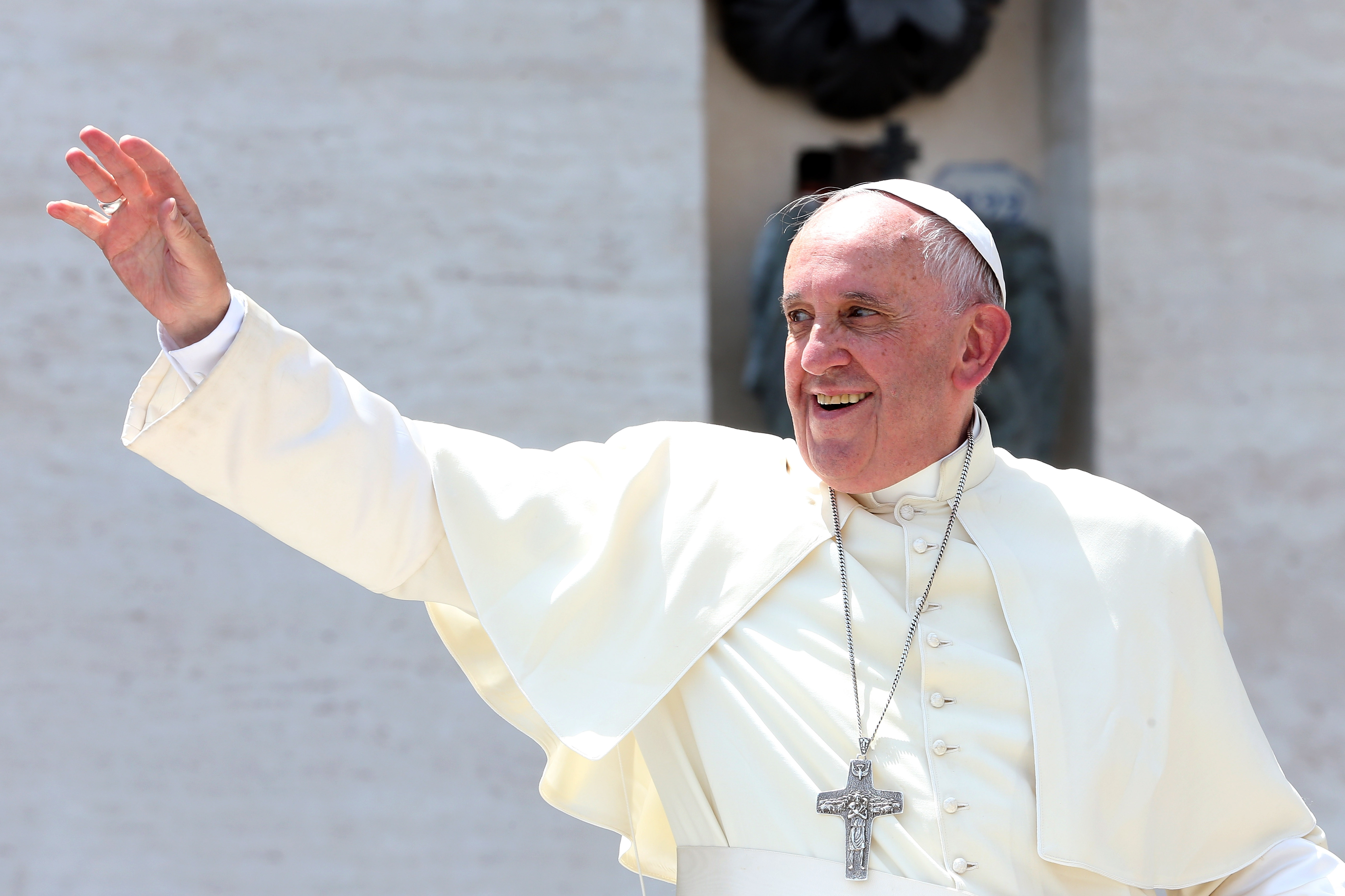 Pope Francis waves to the boy scouts gathered in St. Peter's Square on June 13 in Vatican City, Vatican. The pontiff will address a joint session of Congress on Thursday in Washington, D.C.