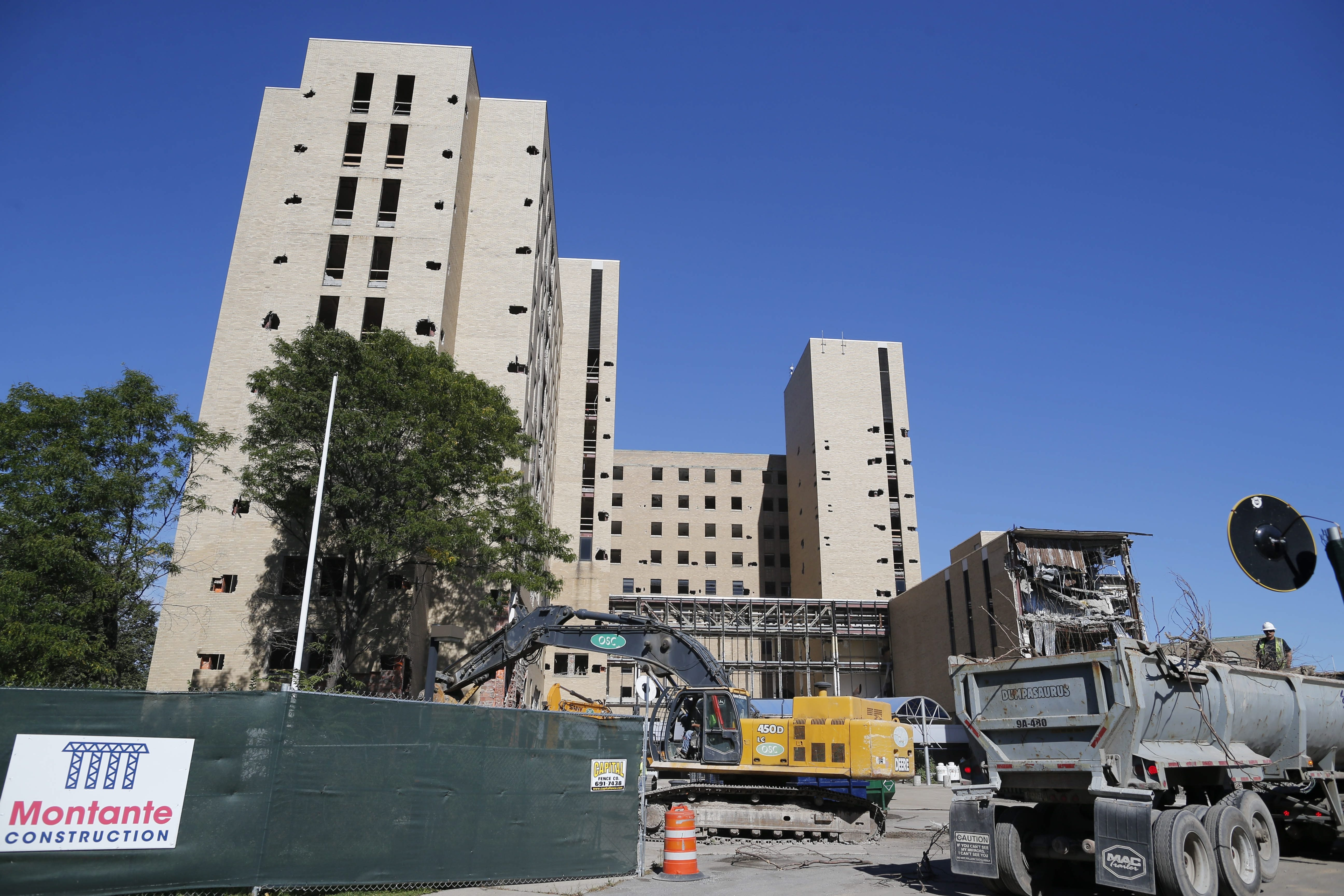Demolition continues at the former Millard Fillmore Hospital at Gates Circle on Monday. The main tower will be imploded Oct. 3 to make way for a $150 million retail and residential development project.