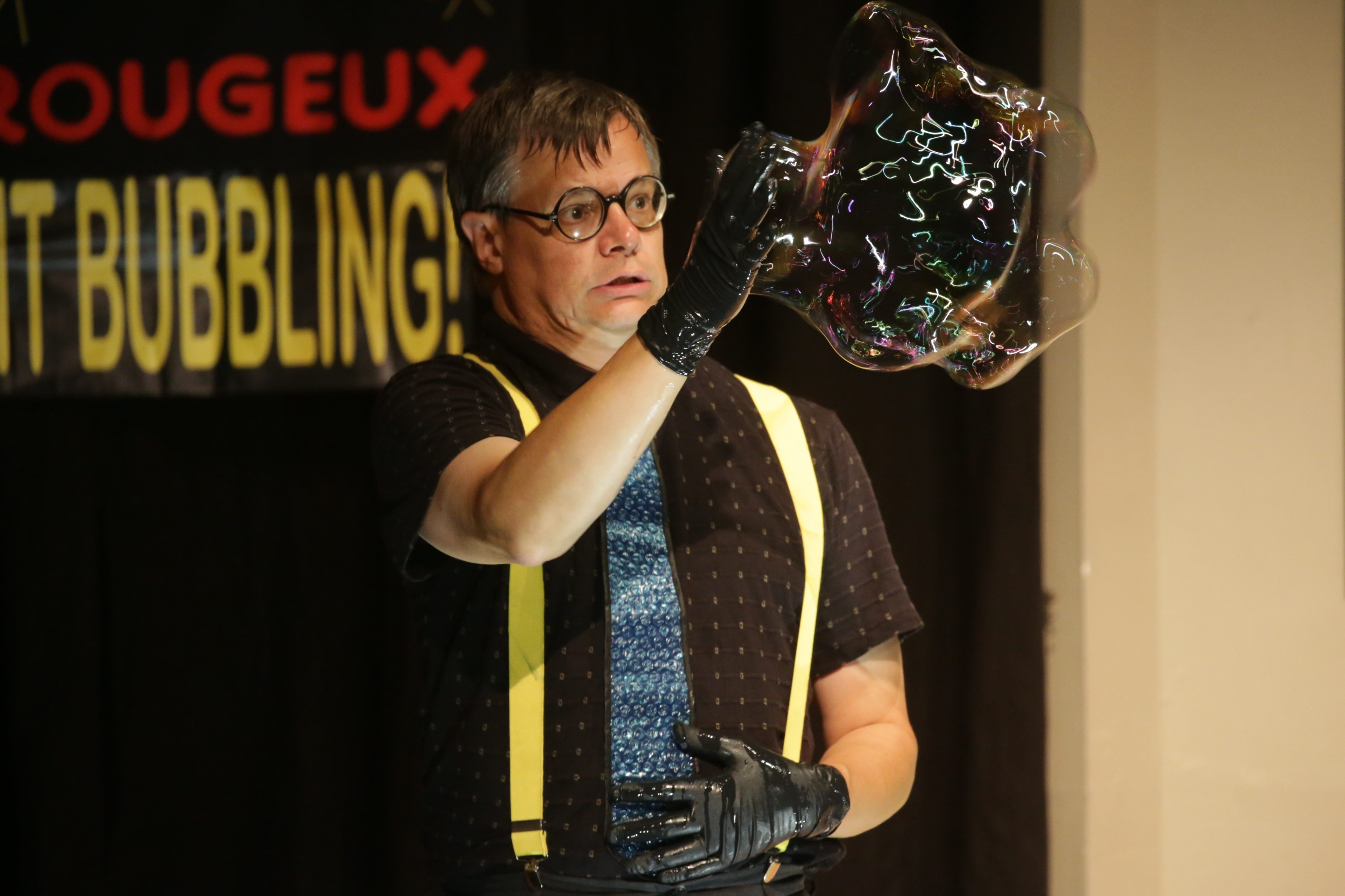 Doug Rougeux makes a large bubble during his Bubblemania show at the Buffalo Museum of Science's Bubblefest on Saturday.
