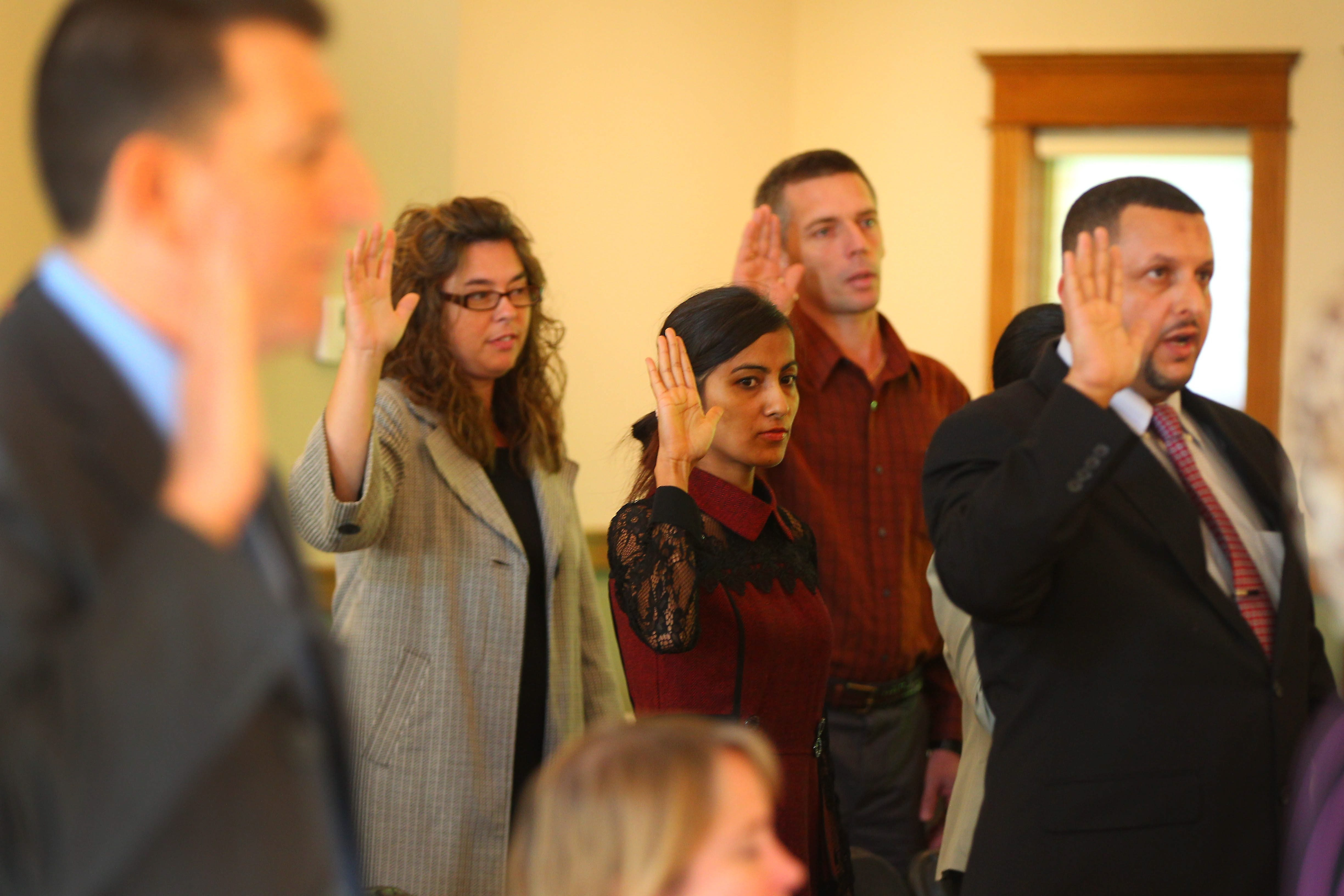 Candidates take the Oath of Allegiance administered by Magistrate Judge Leslie G. Foschio on Monday at the Theodore Roosevelt Inaugural National Historic site in Buffalo.