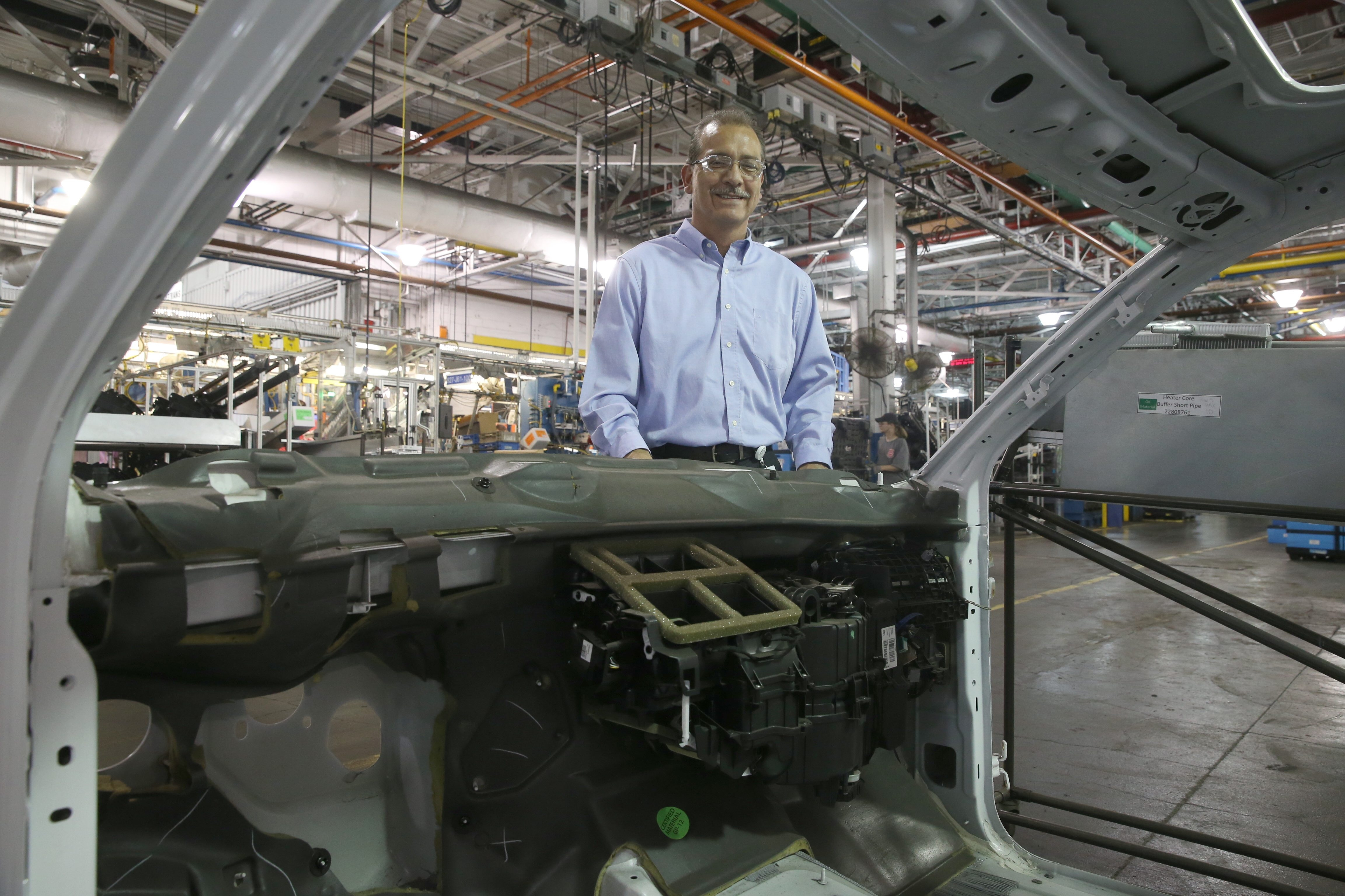 William Tiger, the new plant manager at GM Components Holdings (the former Delphi and Harrison Radiator complex) with the mock up of plastic parts for a Chevy Tahoe in Lockport, N.Y., on Friday,  Aug. 7, 2015. (John Hickey/Buffalo News)