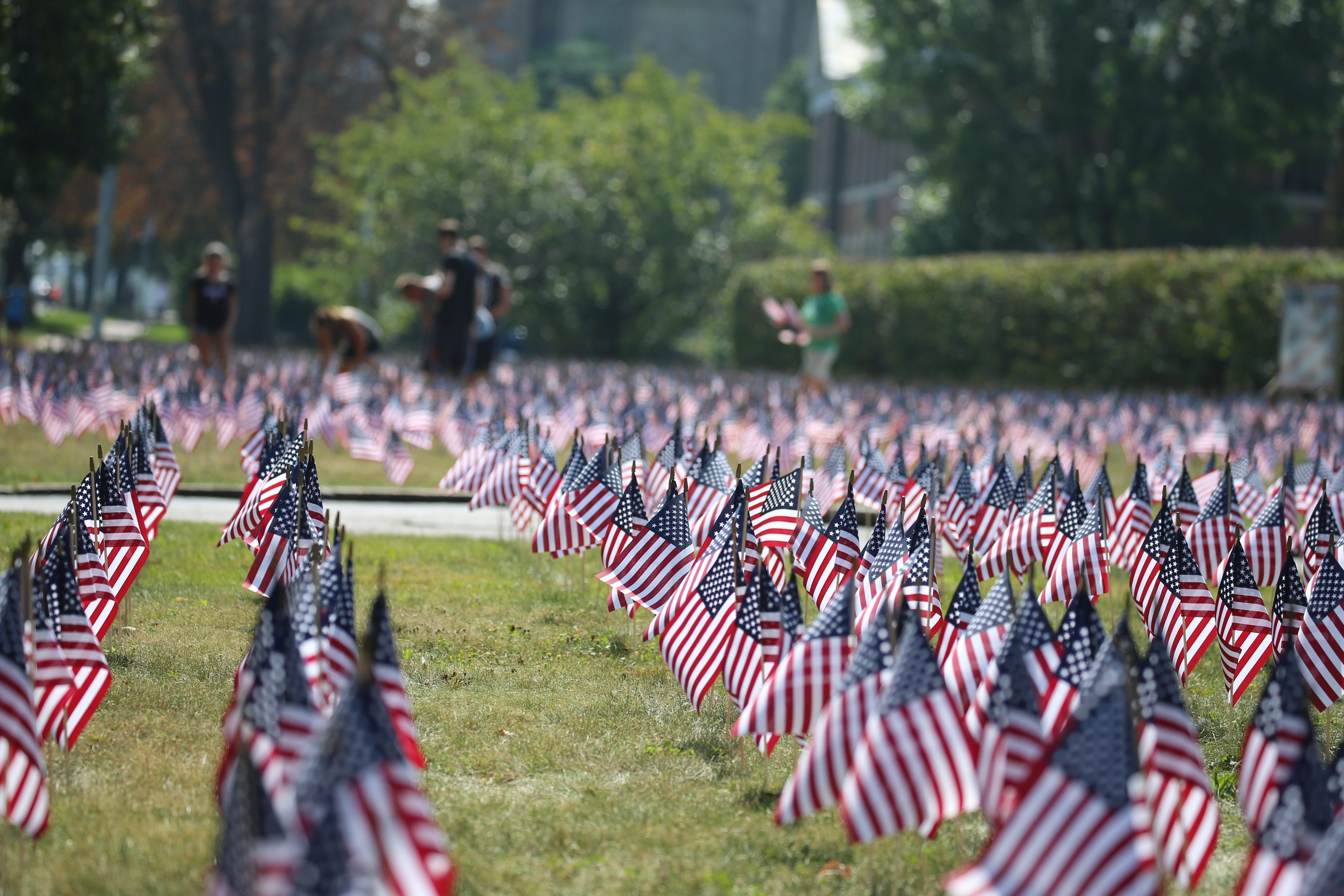 Volunteers from WNY Families of Sept. 11 placed 3,000 American flags on the lawn of the Buffalo Chapter of the American Red Cross on Delaware Avenue in honor of the victims of the 9/11 terror attacks. (John Hickey/Buffalo News)