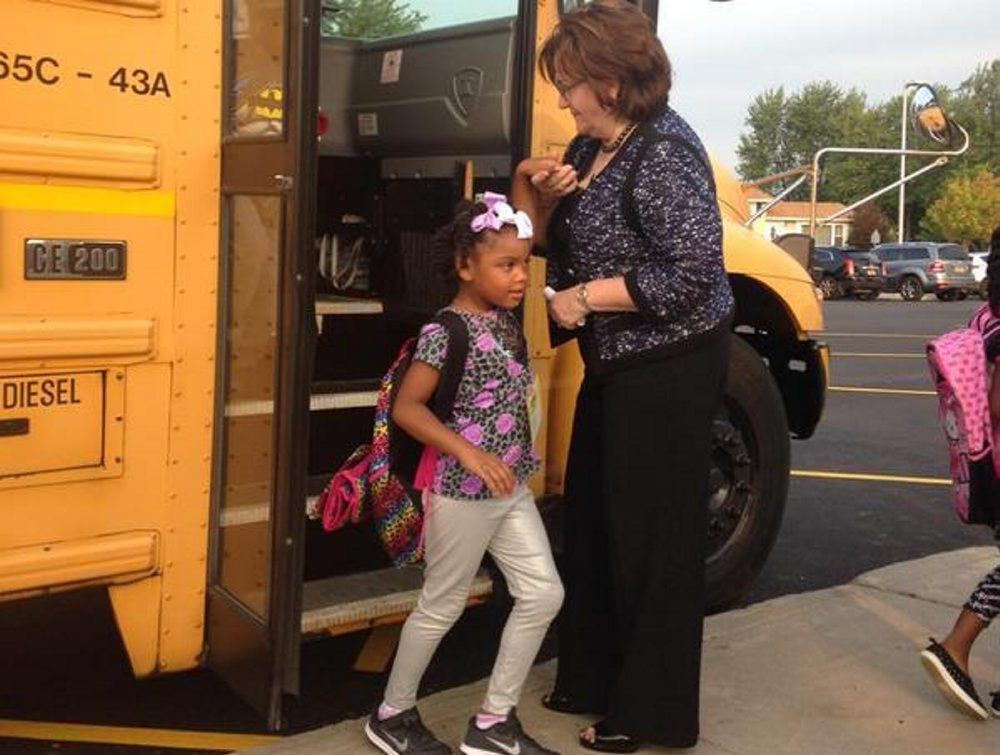 State Education Commissioner MaryEllen Elia greets students arriving at Glendale Elementary in the Sweet Home District, where she worked as a teacher at the high school, on the first day of school Wednesday.