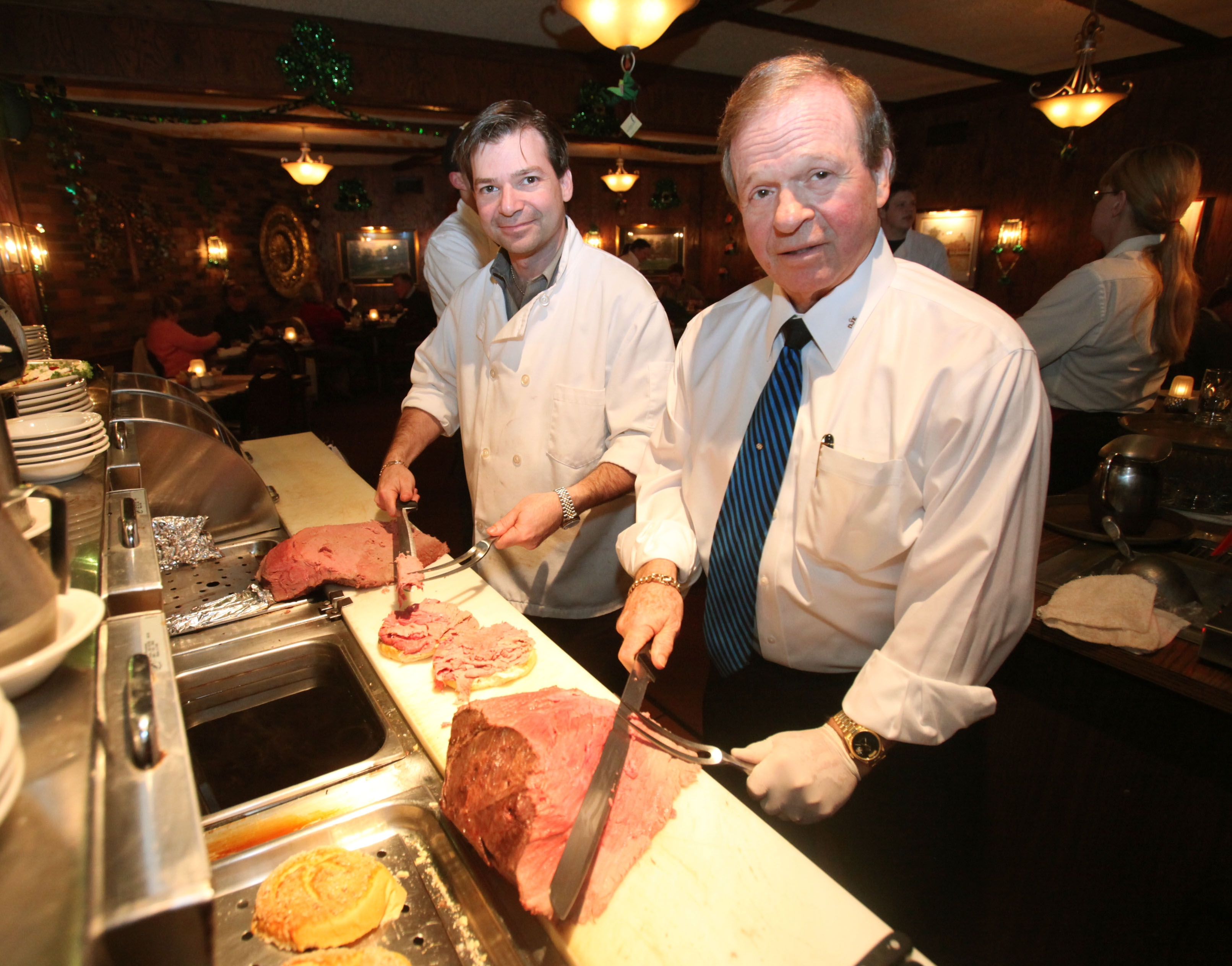Eckl's Restaurant in Orchard Park is closing on   Sept. 26. Owner Dale Eckl, right, and his son Dale, Jr. cut  roast beef sandwiches in this photo from 2010. (News file photo)